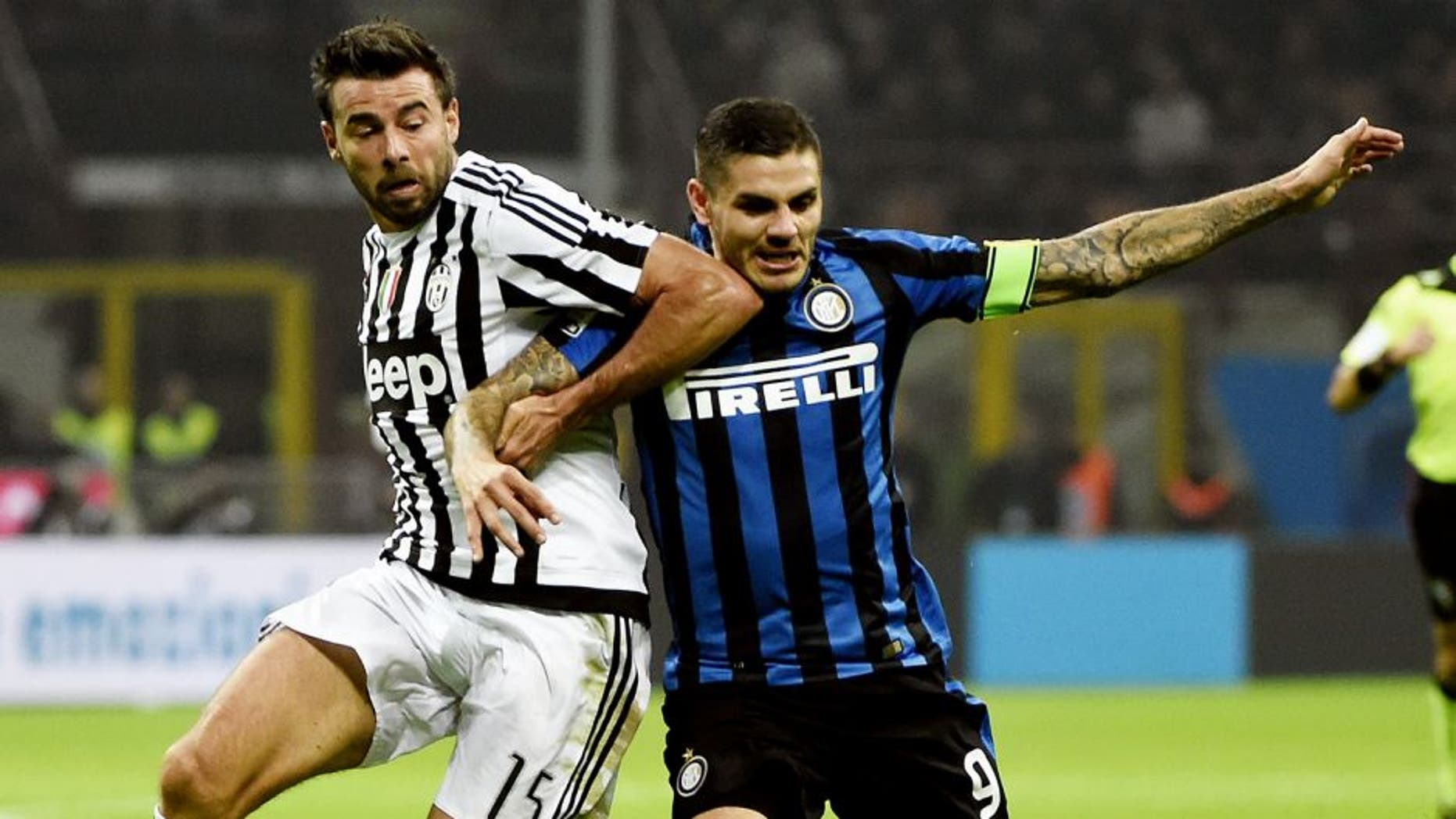 Juventus' defender from Italy Andrea Barzagli (L) fights for the ball Inter Milan's forward from Argentina Mauro Icardi during the Italian Serie A football match Inter Milan vs Juventus on October18, 2015 at the San Siro Stadium stadium in Milan. AFP PHOTO / OLIVIER MORIN (Photo credit should read OLIVIER MORIN/AFP/Getty Images)