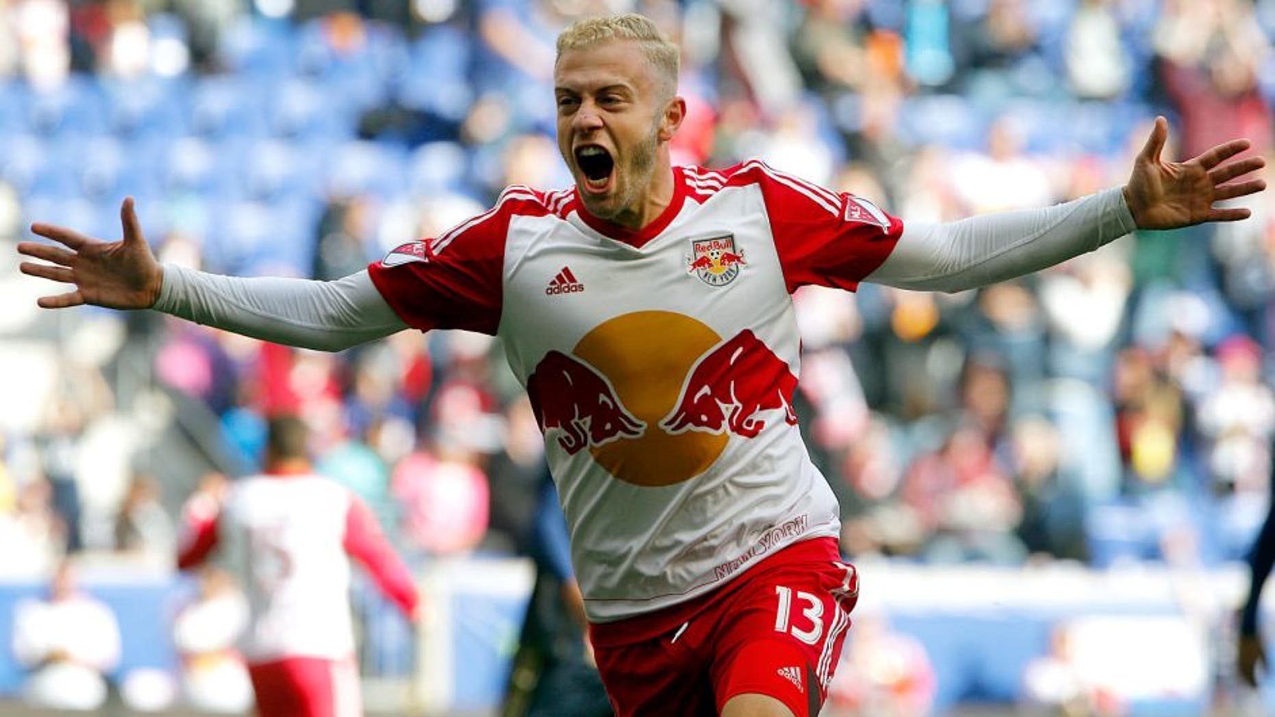 Oct 18, 2015; Harrison, NJ, USA; New York Red Bulls forward Mike Grella (13) reacts after a goal during first half against Philadelphia Union at Red Bull Arena. Mandatory Credit: Noah K. Murray-USA TODAY Sports