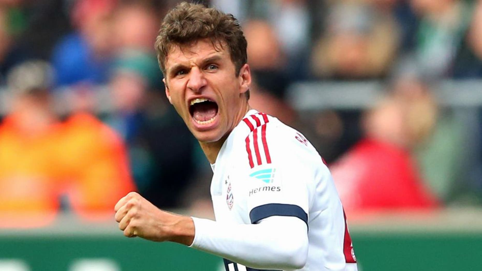 BREMEN, GERMANY - OCTOBER 17: Thomas Mueller of Muenchen celebrates scoring the opening goal during the Bundesliga match between SV Werder Bremen and FC Bayern Muenchen at Weserstadion on October 17, 2015 in Bremen, Germany. (Photo by Alexander Hassenstein/Bongarts/Getty Images)