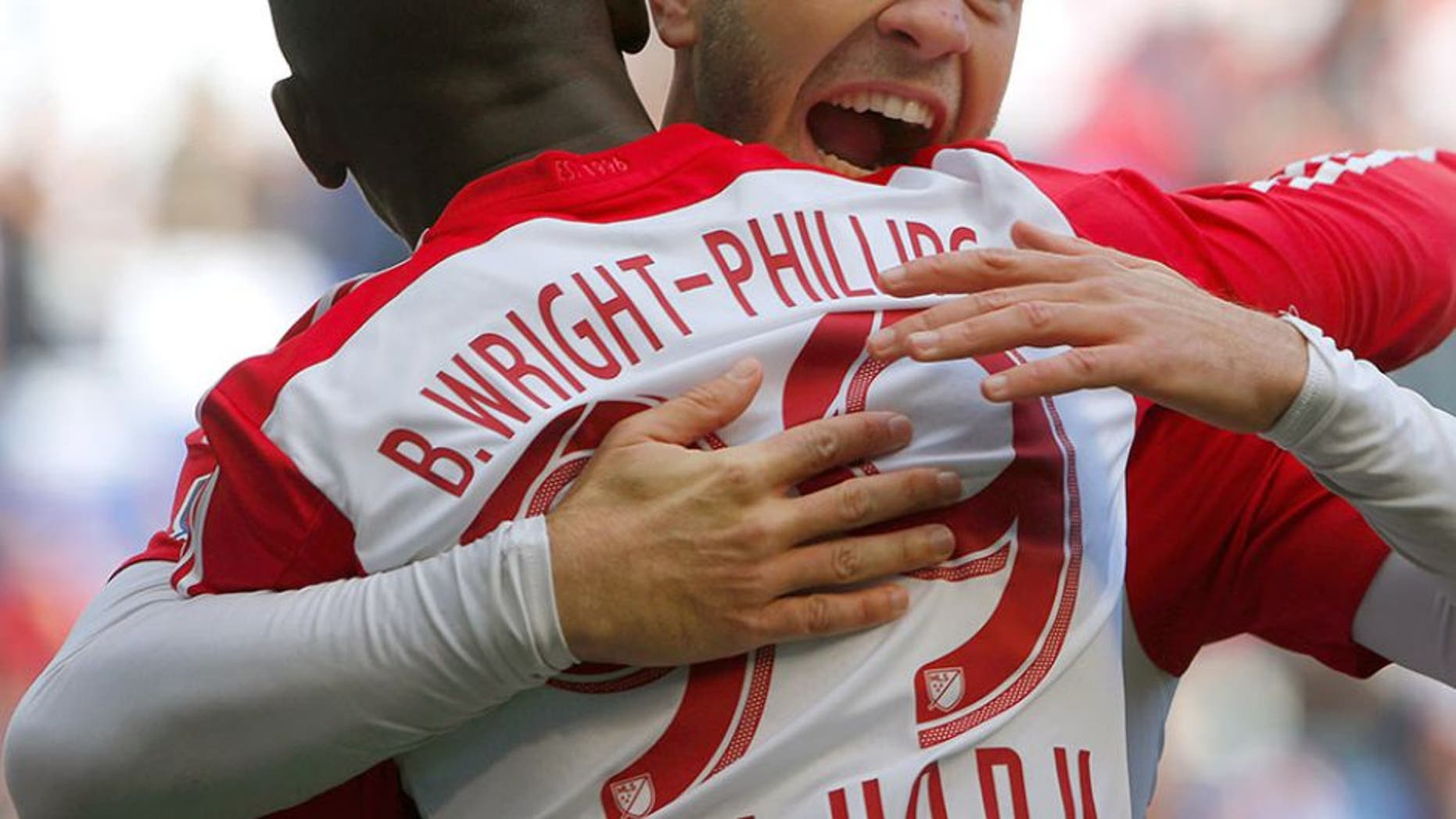 Oct 18, 2015; Harrison, NJ, USA; New York Red Bulls forward Mike Grella (13) hugs New York Red Bulls forward Bradley Wright-Phillips (99) after he scored a goal during first half against Philadelphia Union at Red Bull Arena. Mandatory Credit: Noah K. Murray-USA TODAY Sports