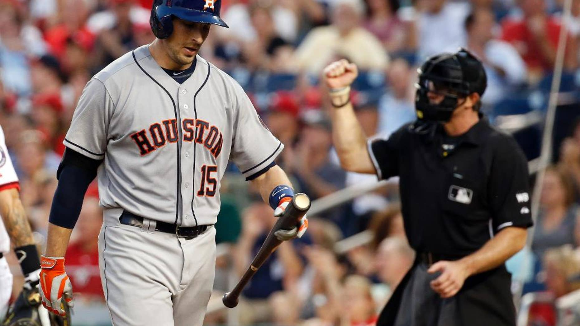 Houston Astros' Jason Castro walks away after striking out with the bases loaded during the fourth inning of an interleague baseball game against the Washington Nationals at Nationals Park Tuesday, June 17, 2014, in Washington. (AP Photo/Alex Brandon)