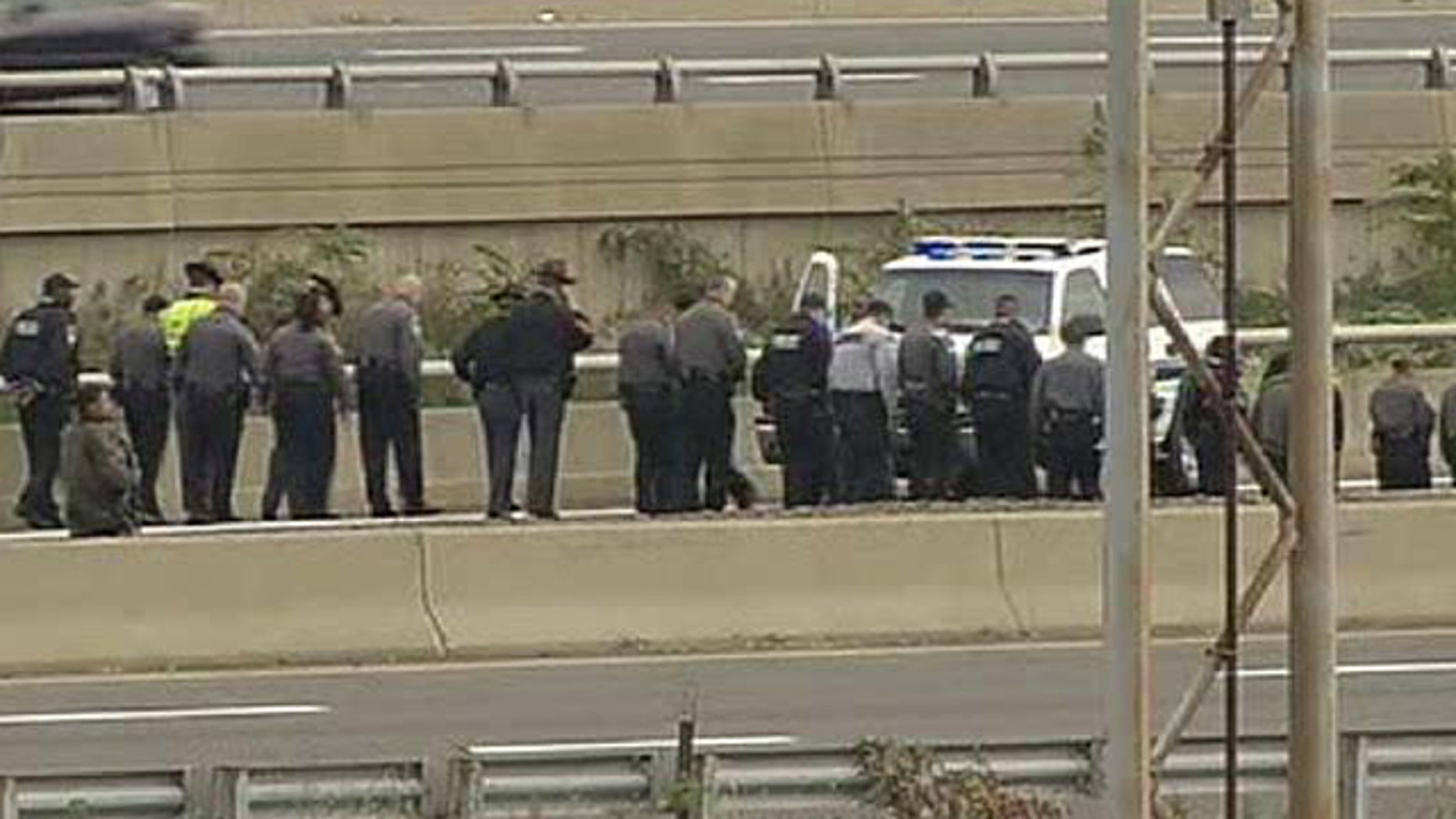 Oct. 19: Law Enforcement Officers search for evidence along the I-395 expressway adjacent to the Pentagon (Fox News).