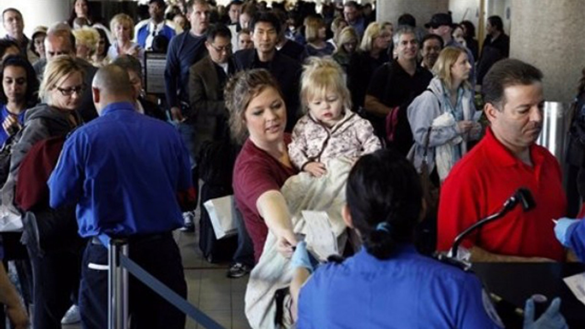 April 8: Airline passengers line-up inside terminals at Los Angeles International Airport after several terminals were closed due to a security breach.