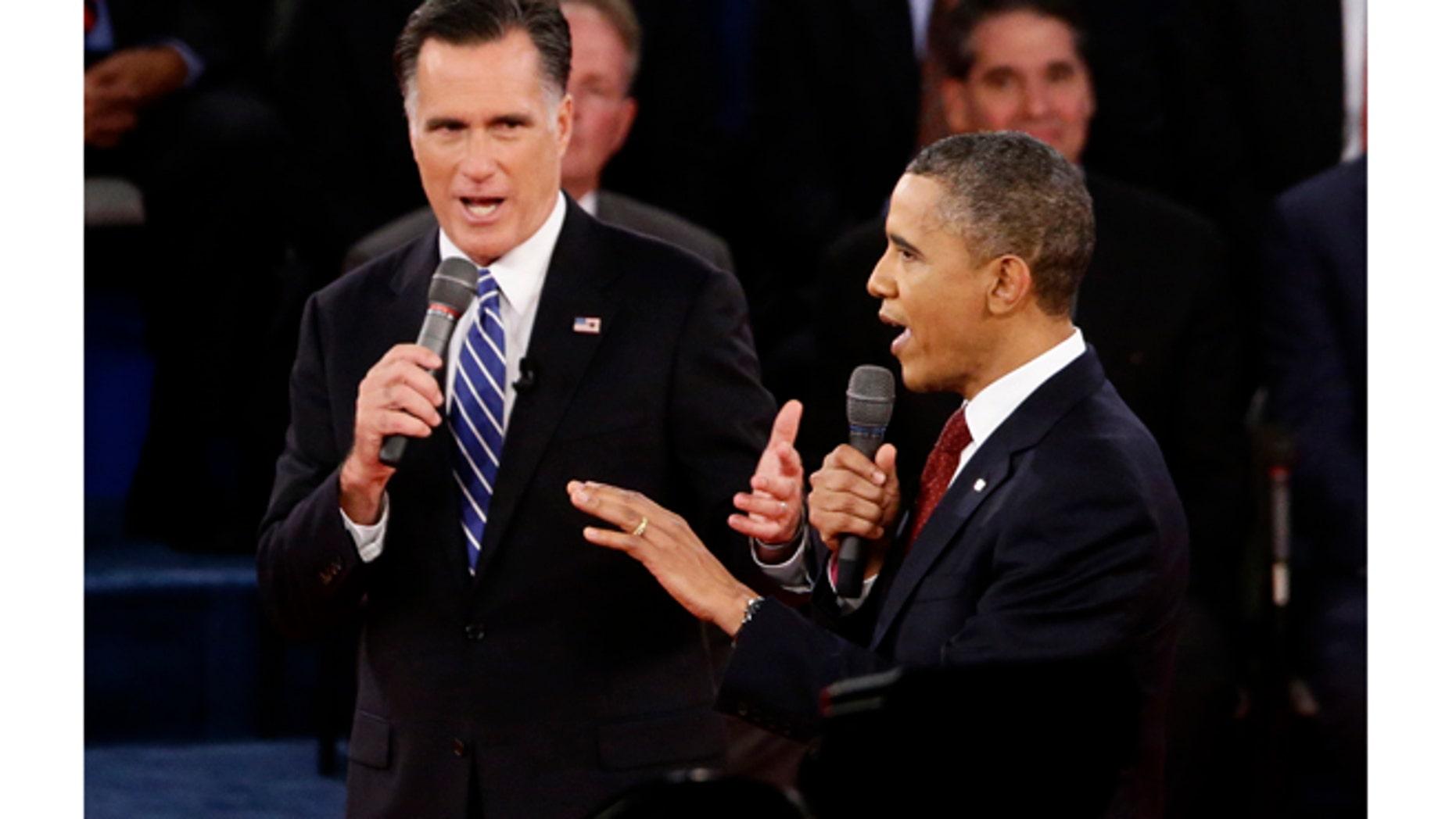 FILE: Oct. 16, 2012: President Barack Obama and Mitt Romney in the second presidential debate, at Hofstra University, in Long Island, N.Y.