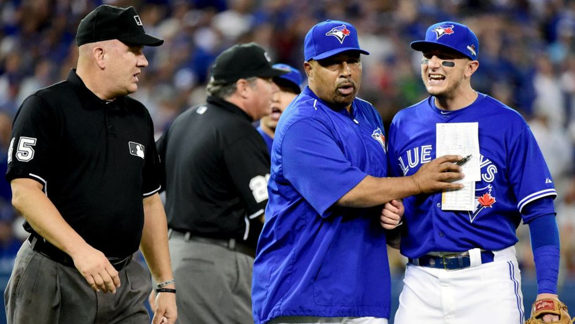 TORONTO, ON - OCTOBER 19: Troy Tulowitzki #2 of the Toronto Blue Jays reacts as he is ejected from the game in the eighth inning against the Kansas City Royals during game three of the American League Championship Series at Rogers Centre on October 19, 2015 in Toronto, Canada. (Photo by Harry How/Getty Images)