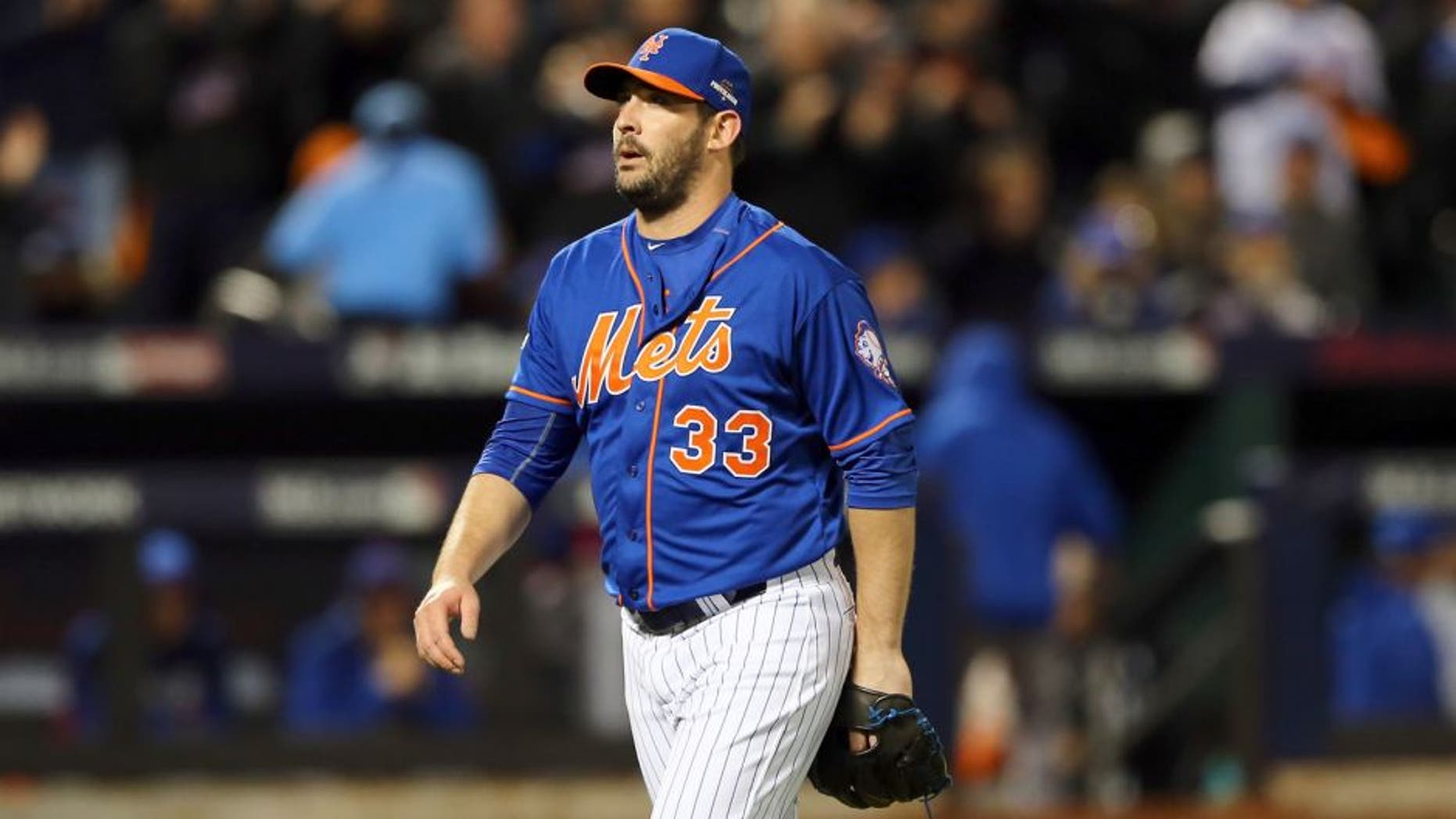 NEW YORK, NY - OCTOBER 17: Matt Harvey #33 of the New York Mets walks back to the dugout after closing out an inning against the Chicago Cubs during game one of the 2015 MLB National League Championship Series at Citi Field on October 17, 2015 in the Flushing neighborhood of the Queens borough of New York City. (Photo by Elsa/Getty Images)