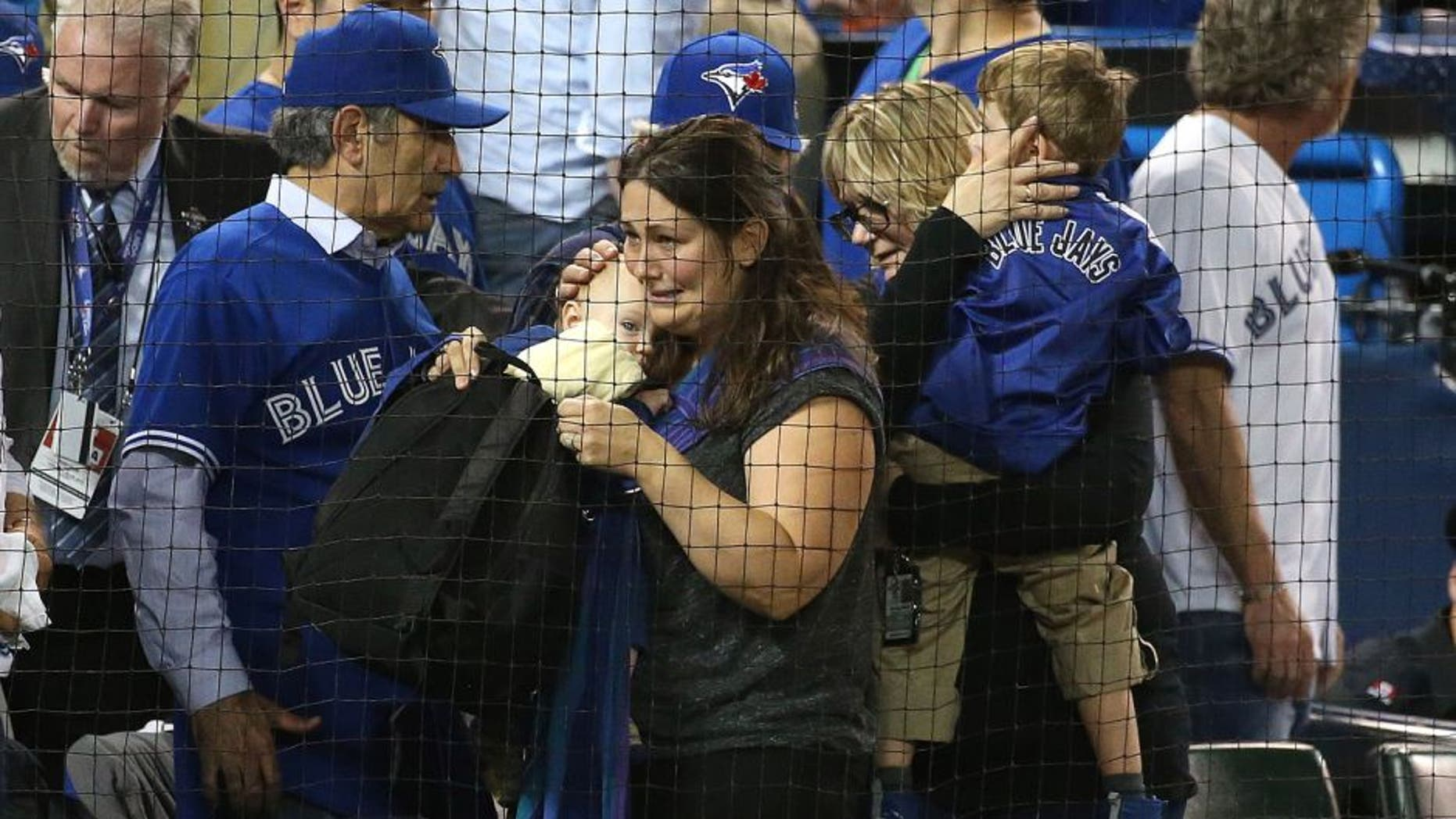 TORONTO, ON- OCTOBER 14: An infant was allegedly hit by a beer can during the protest. The Toronto Blue Jays and Texas Rangers play game four of the MLB American League Division Series . at Rogers Centre in Toronto. October 14, 2015. (Steve Russell/Toronto Star via Getty Images)