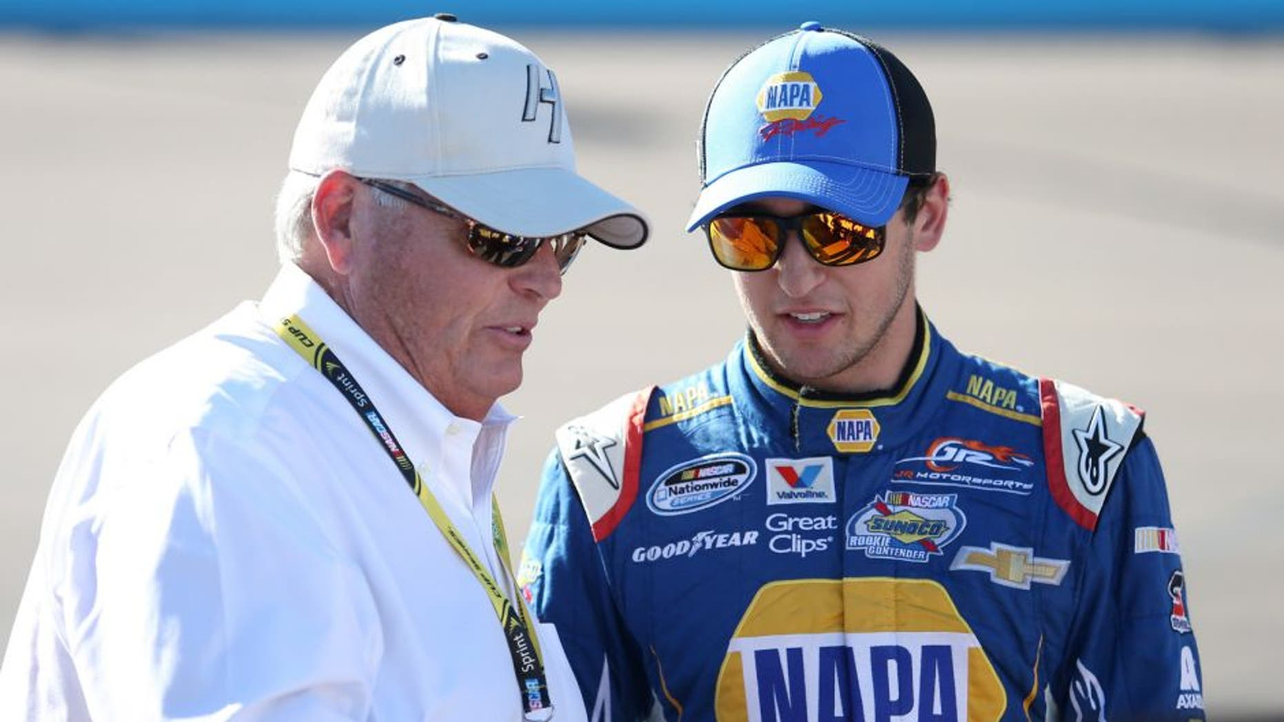 AVONDALE, AZ - NOVEMBER 08: Chase Elliott, driver of the #9 NAPA Auto Parts Chevrolet, stands on the grid with team owner Rick Hendrick prior to the NASCAR Nationwide Series DAV 200 at Phoenix International Raceway on November 8, 2014 in Avondale, Arizona. (Photo by Todd Warshaw/Getty Images)