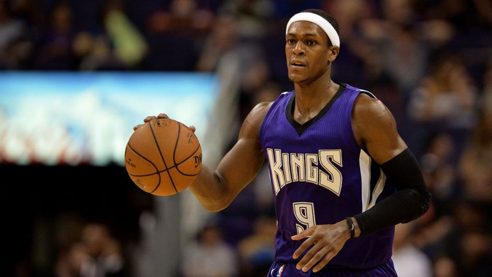 Oct 7, 2015; Phoenix, AZ, USA; Sacramento Kings guard Rajon Rondo (9) dribbles the basketball up the court in the second half against the Phoenix Suns at Talking Stick Resort Arena. The Suns defeat the Kings 102-98. Mandatory Credit: Jennifer Stewart-USA TODAY Sports