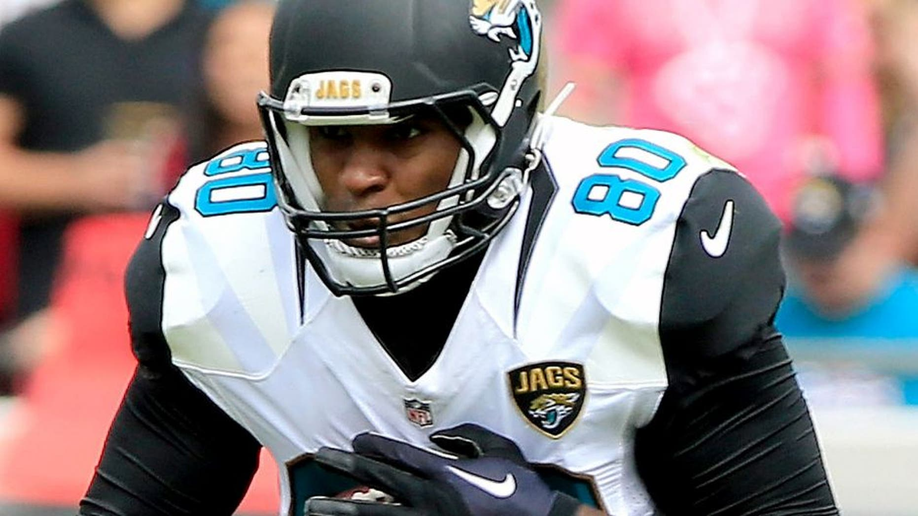 JACKSONVILLE, FL - OCTOBER 18: Julius Thomas #80 of the Jacksonville Jaguars makes a reception against Kevin Johnson #30 of the Houston Texans during the game at EverBank Field on October 18, 2015 in Jacksonville, Florida. (Photo by Sam Greenwood/Getty Images)