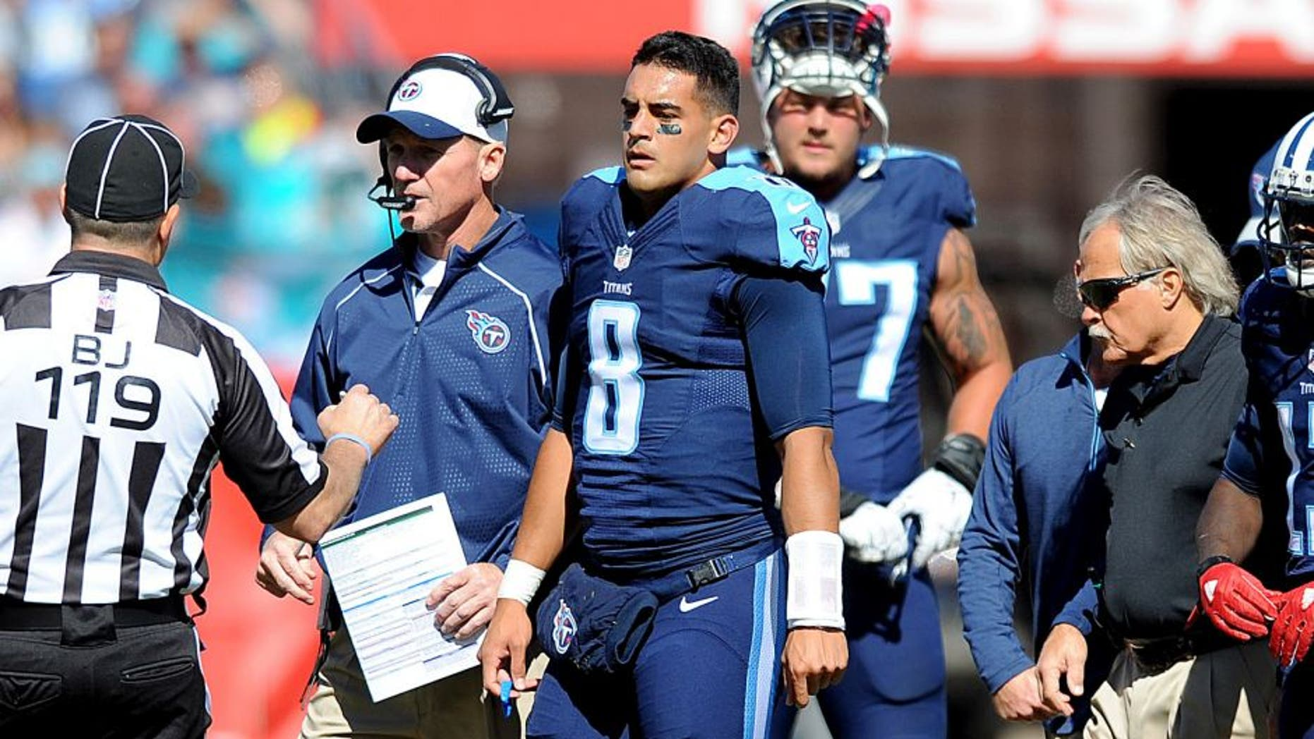 Oct 18, 2015; Nashville, TN, USA; Tennessee Titans quarterback Marcus Mariota (8) is helped off the field after an injury during the first half against the Miami Dolphins at Nissan Stadium. Mandatory Credit: Christopher Hanewinckel-USA TODAY Sports