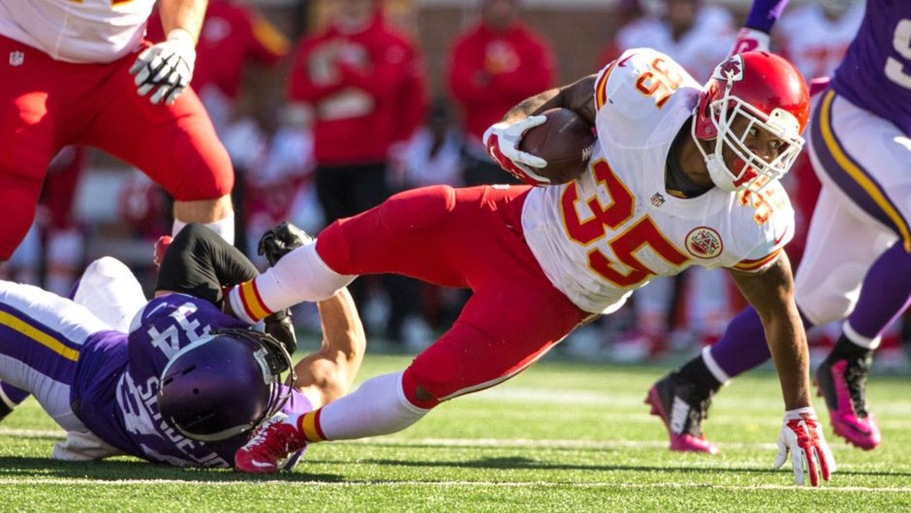 Oct 18, 2015; Minneapolis, MN, USA; Kansas City Chiefs running back Charcandrick West (35) is tackled by Minnesota Vikings safety Andrew Sendejo (34) during the fourth quarter at TCF Bank Stadium. The Vikings defeated the Chiefs 16-10. Mandatory Credit: Brace Hemmelgarn-USA TODAY Sports