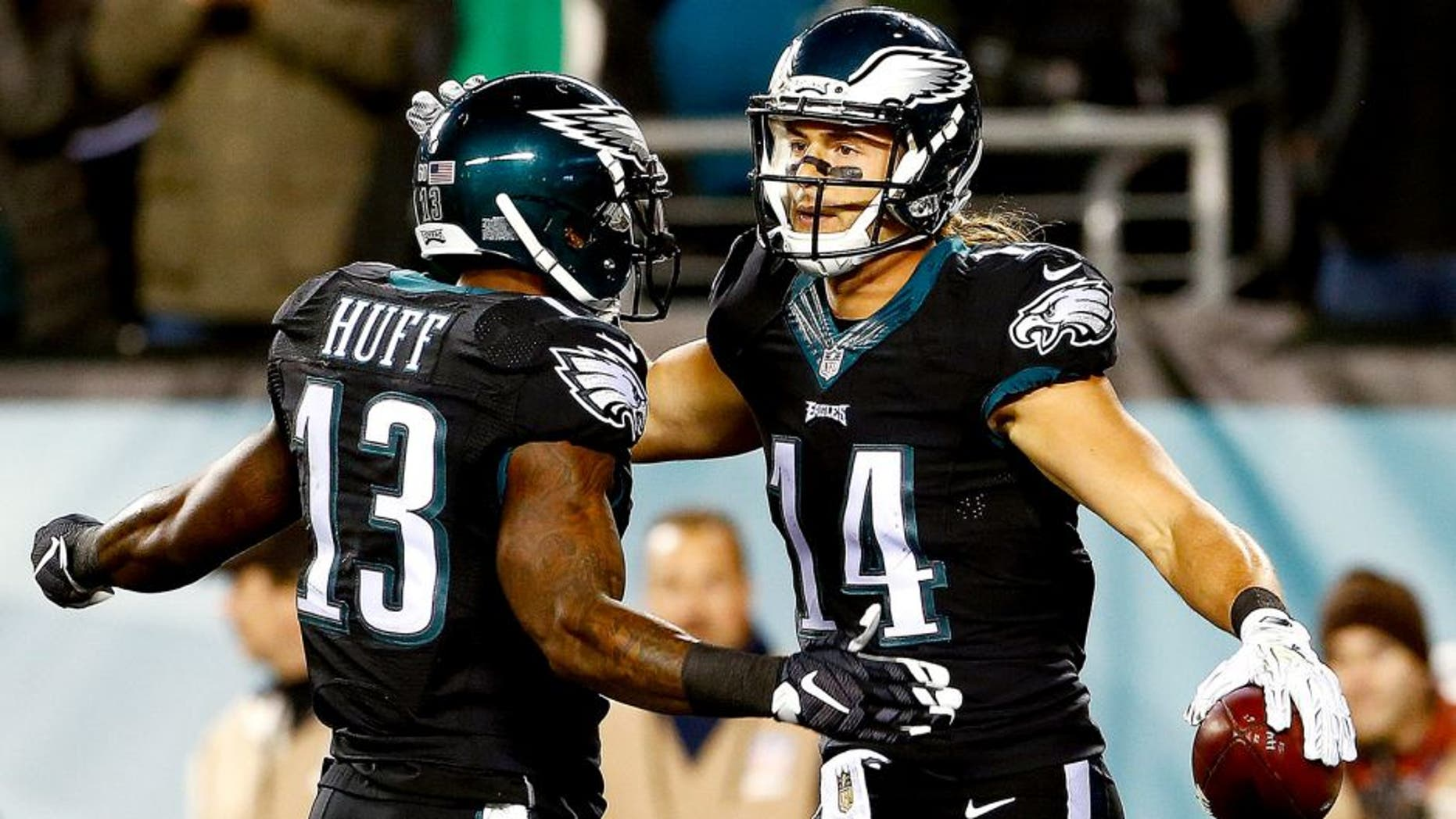 PHILADELPHIA, PA - OCTOBER 19: Riley Cooper #14 of the Philadelphia Eagles is congratulated by his teammate Josh Huff #13 after scoring a first quarter touchdown against the New York Giants at Lincoln Financial Field on October 19, 2015 in Philadelphia, Pennsylvania. (Photo by Rich Schultz/Getty Images)