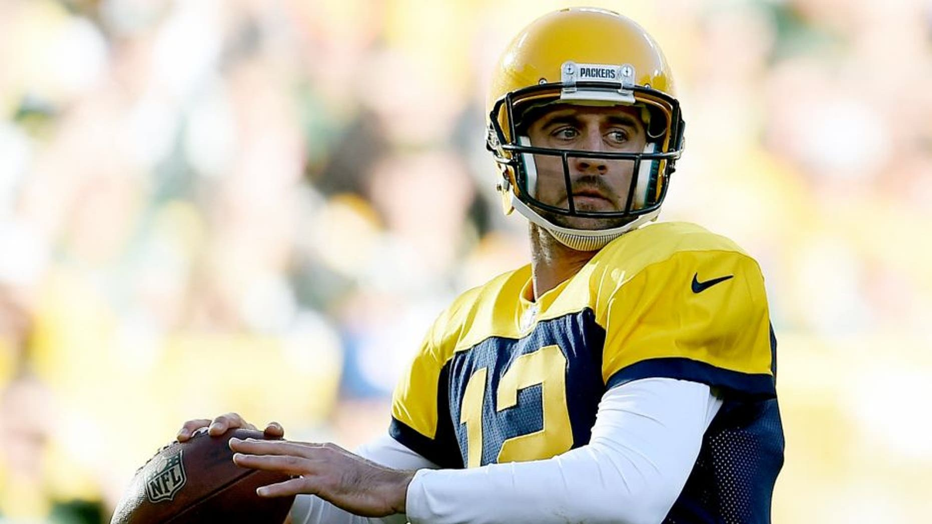 GREEN BAY, WI - OCTOBER 18: Aaron Rodgers #12 of the Green Bay Packers drops back to pass during a game against the San Diego Chargers at Lambeau Field on October 18, 2015 in Green Bay, Wisconsin. Green Bay defeated San Diego 27-20. (Photo by Stacy Revere/Getty Images)