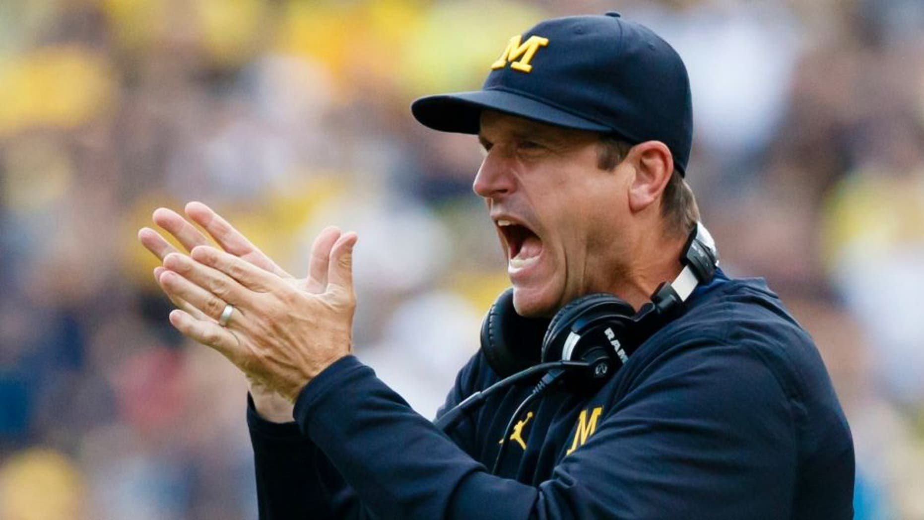 Sep 10, 2016; Ann Arbor, MI, USA; Michigan Wolverines head coach Jim Harbaugh claps after a touchdown in the second half against the UCF Knights at Michigan Stadium. Michigan won 51-14. Mandatory Credit: Rick Osentoski-USA TODAY Sports