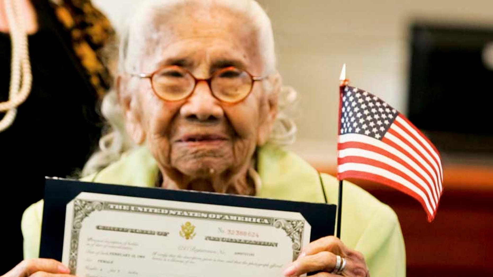 Eulalia Garcia-Maturey, 101, poses with her certificate of naturalization after her naturalization ceremony in Brownsville, Texas, Tuesday, Oct. 12, 2010. Garcia-Maturey became a naturalized U.S. citizen on Tuesday, exactly 101 years after arriving in the U.S. with her parents from Mexico. (AP Photo/The Brownsville Herald, Yvette Vela)