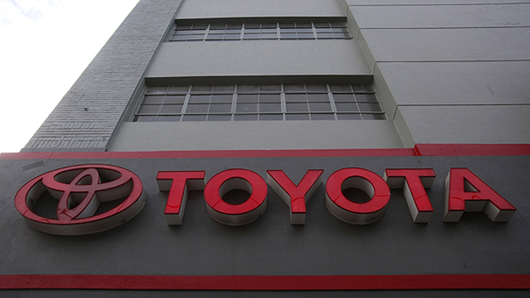 The sign at San Francisco Toyota car dealership is shown in San Francisco, in this Jan. 26, 2010 file photo. Toyota Motor Corp. said Thursday Oct. 21 it is recalling 1.53 million Lexus, Avalon and other models, mostly in the U.S. and Japan, for brake fluid and fuel pump problems.