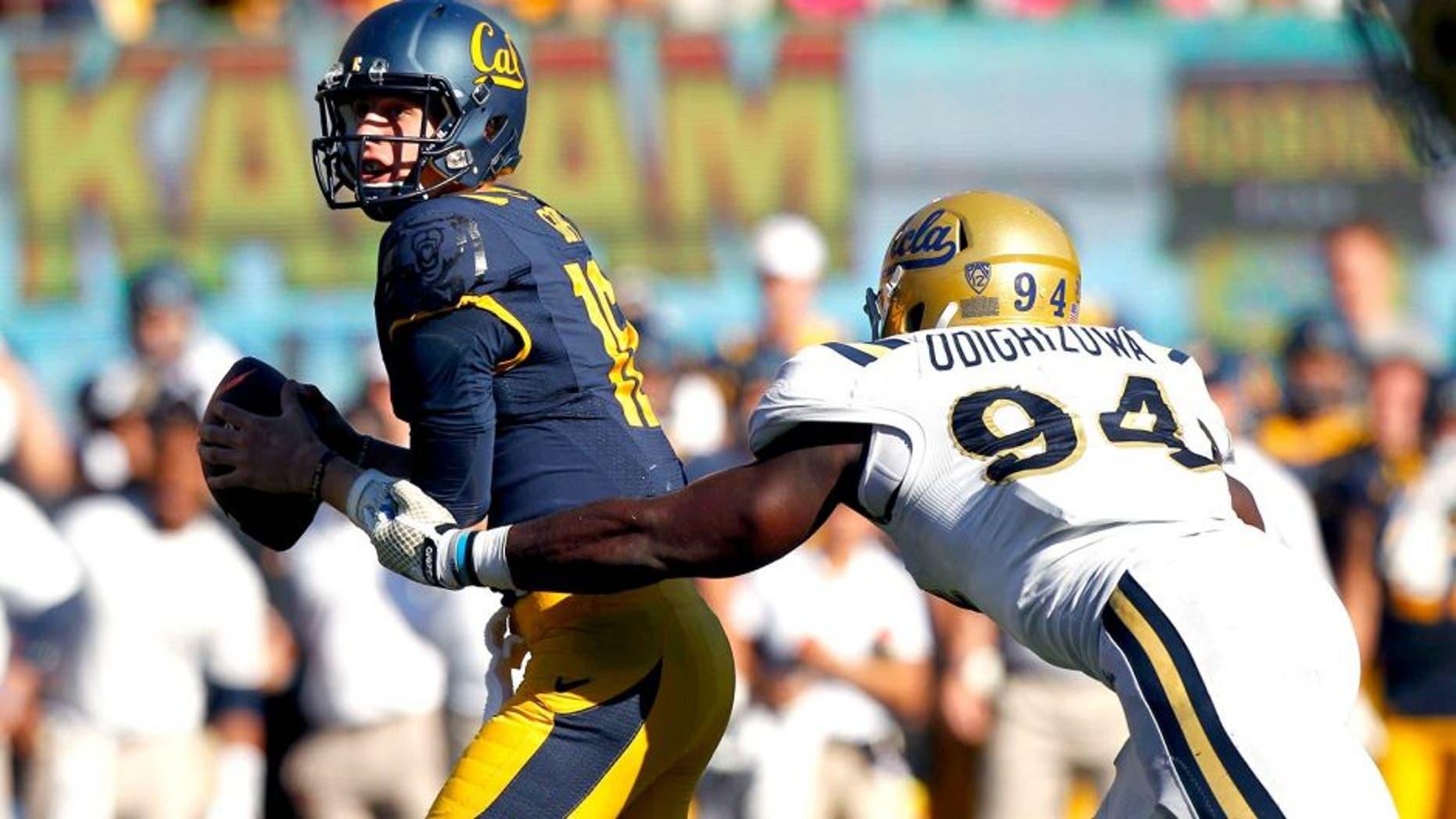 Oct 18, 2014; Berkeley, CA, USA; California Golden Bears quarterback Jared Goff (16) is unable to elude UCLA Bruins defensive lineman Owamagbe Odighizuwa (94) in the fourth quarter at Memorial Stadium. The Bruins defeated the Golden Bears 36-34. Mandatory Credit: Cary Edmondson-USA TODAY Sports