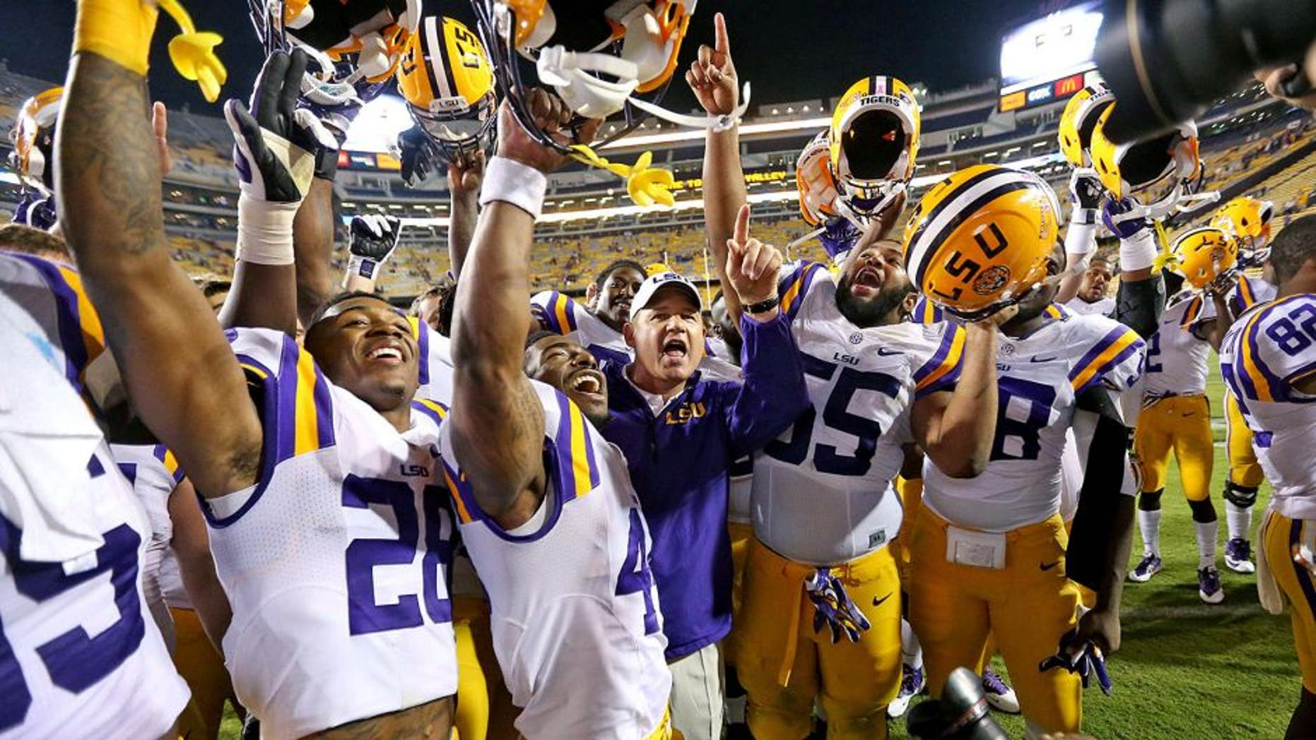 Oct 18, 2014; Baton Rouge, LA, USA; LSU Tigers head coach Les Miles and the Tigers celebrate their 41-3 victory against the Kentucky Wildcats at Tiger Stadium. Mandatory Credit: Crystal LoGiudice-USA TODAY Sports