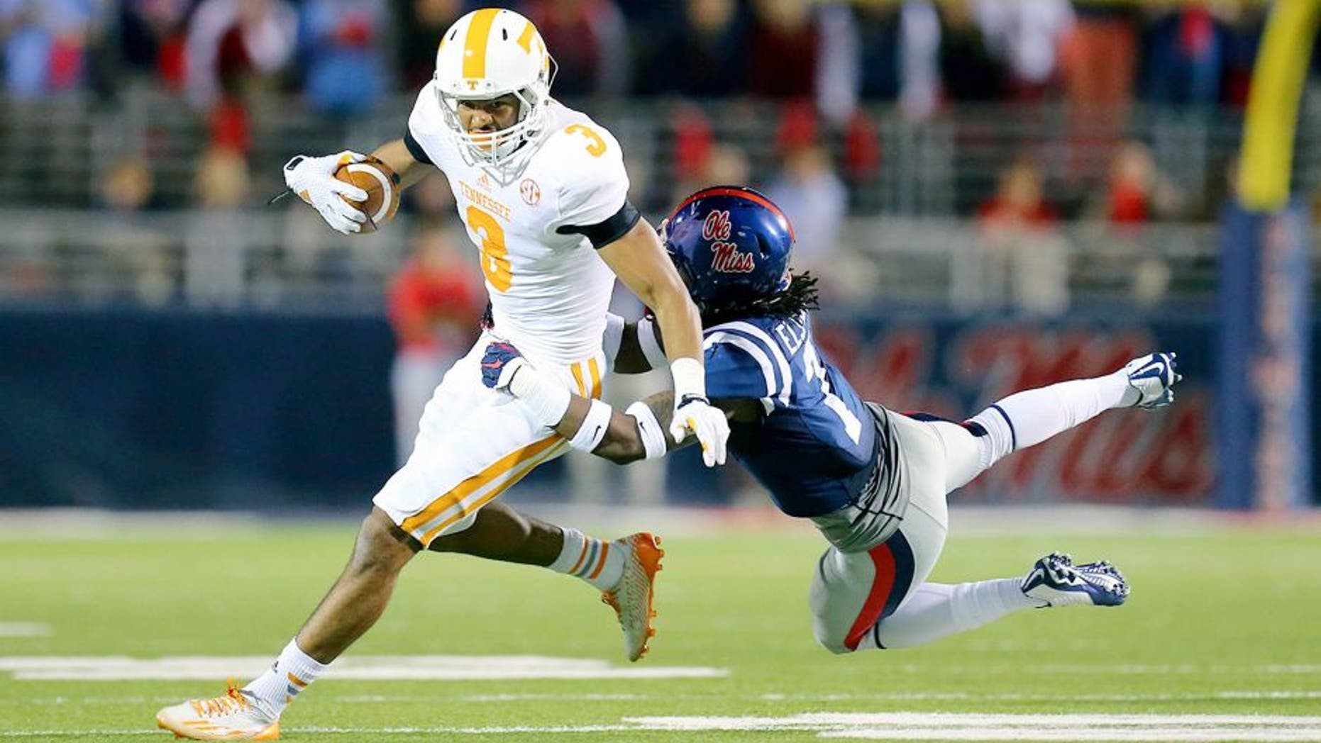 Oct 18, 2014; Oxford, MS, USA; Tennessee Volunteers wide receiver Josh Malone (3) is tackled by Mississippi Rebels defensive back Trae Elston (7) during the game at Vaught-Hemingway Stadium. The Mississippi Rebels defeated the Tennessee Volunteers 34-3. Mandatory Credit: Spruce Derden-USA TODAY Sports