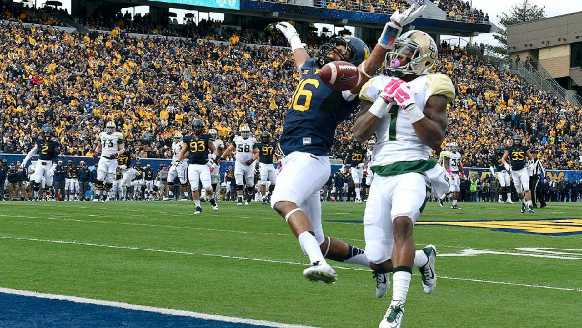 Oct 18, 2014; Morgantown, WV, USA; West Virginia Mountaineers cornerback Terrell Chestnut (16) breaks up a intended pass to Baylor Bears running back Corey Coleman (1) on the goal line during the first quarter at Milan Puskar Stadium. Mandatory Credit: Tommy Gilligan-USA TODAY Sports