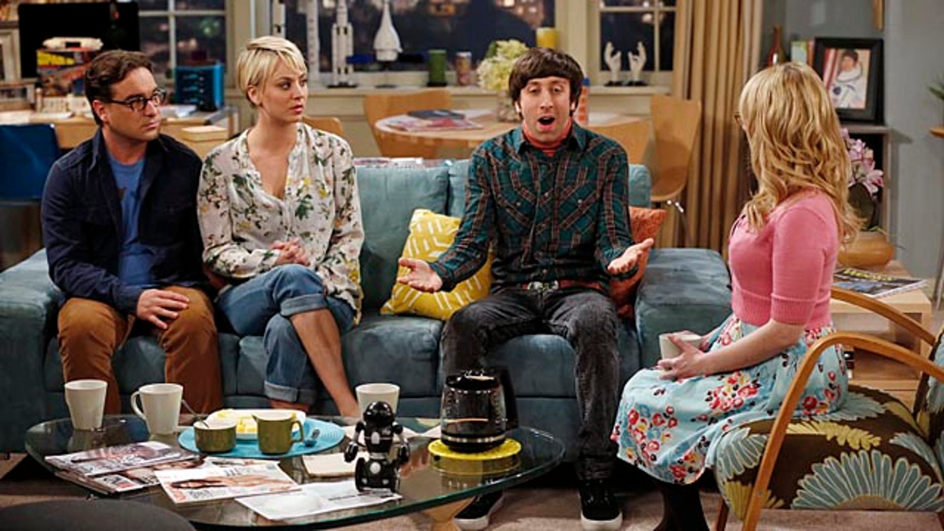 Johnny Galecki, Kaley Cuoco-Sweeting, Simon Helberg and Melissa Rauch discuss money on 'The Big Bang Theory'. (Monty Brinton/CBS)
