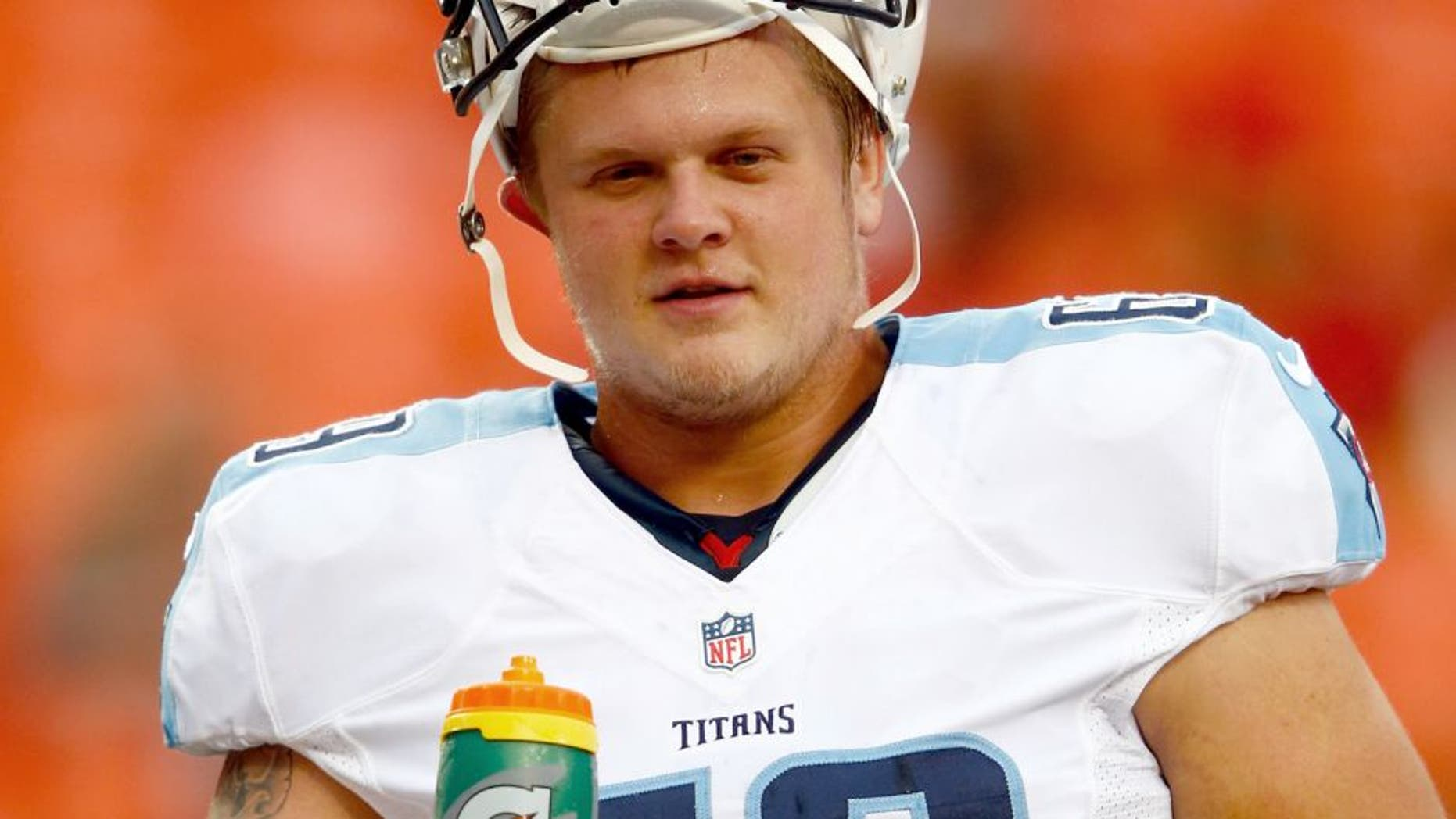 KANSAS CITY, MO - AUGUST 28: Center Andy Gallik #69 of the Tennessee Titans warms up prior to the preseason game against the Kansas City Chiefs at Arrowhead Stadium on August 28, 2015 in Kansas City, Missouri. (Photo by Jamie Squire/Getty Images)