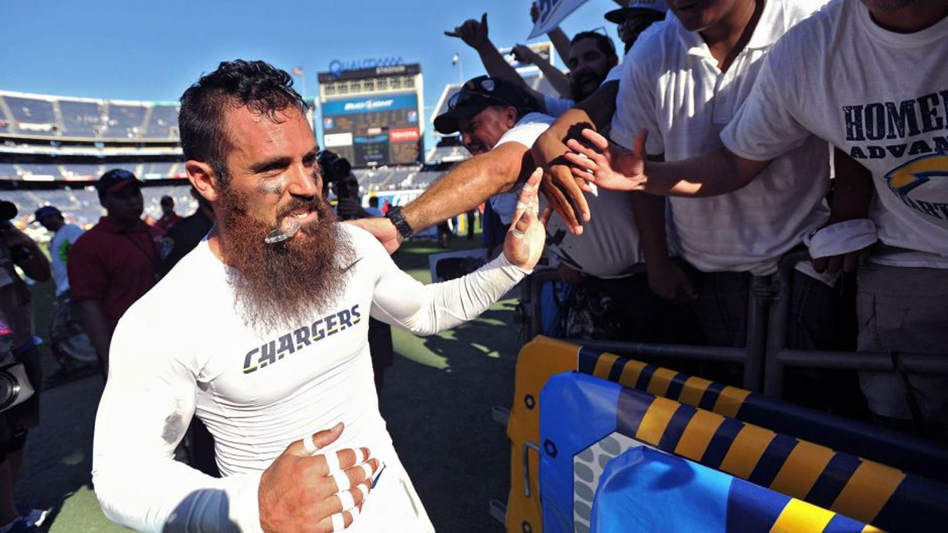 Sep 13, 2015; San Diego, CA, USA; San Diego Chargers free safety Eric Weddle (left) thanks the fans after the game against the Detroit Lions at Qualcomm Stadium. San Diego won 33-28. Mandatory Credit: Orlando Ramirez-USA TODAY Sports