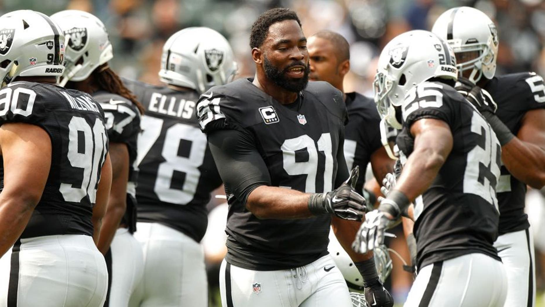 Sep 13, 2015; Oakland, CA, USA; Oakland Raiders defensive end Justin Tuck (91) talks with teammates before the start of the game against the Cincinnati Bengals at O.co Coliseum. Mandatory Credit: Cary Edmondson-USA TODAY Sports
