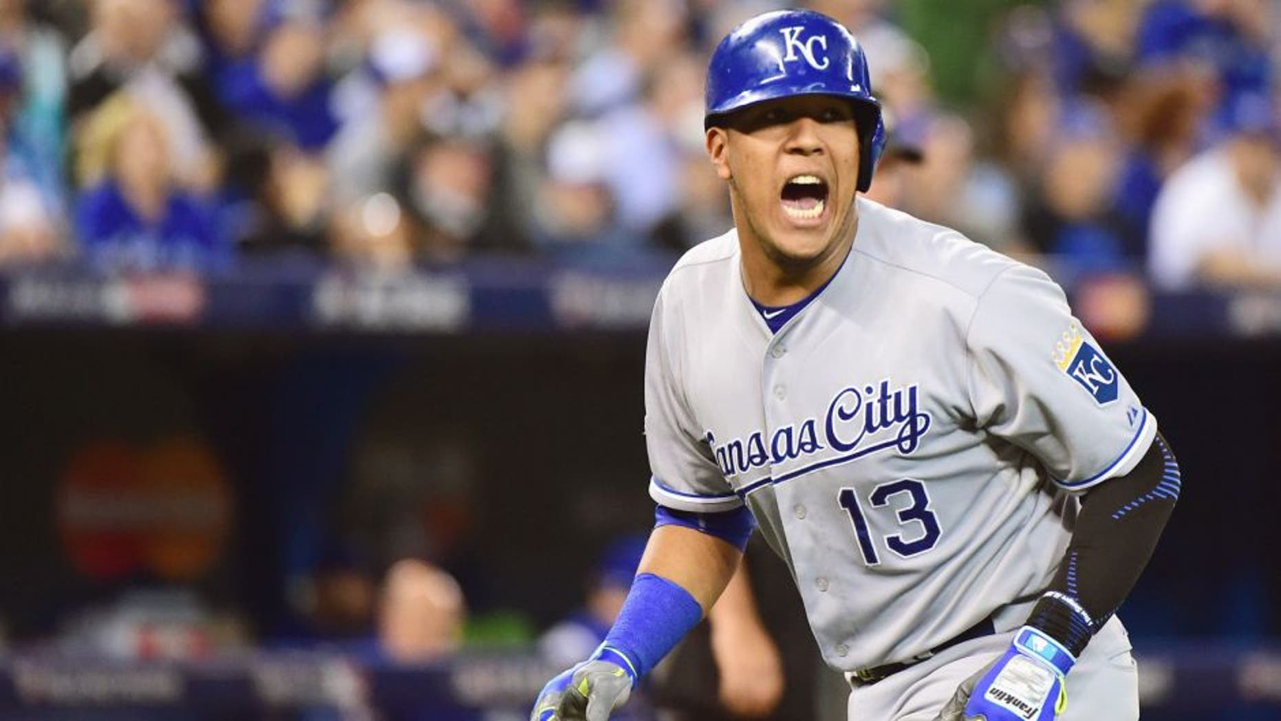 Salvador Perez #13 of the Kansas City Royals reacts after scoring a run in the seventh inning against the Toronto Blue Jays during game four of the American League Championship Series at Rogers Centre on October 20, 2015 in Toronto, Canada. (Photo by Harry How/Getty Images)