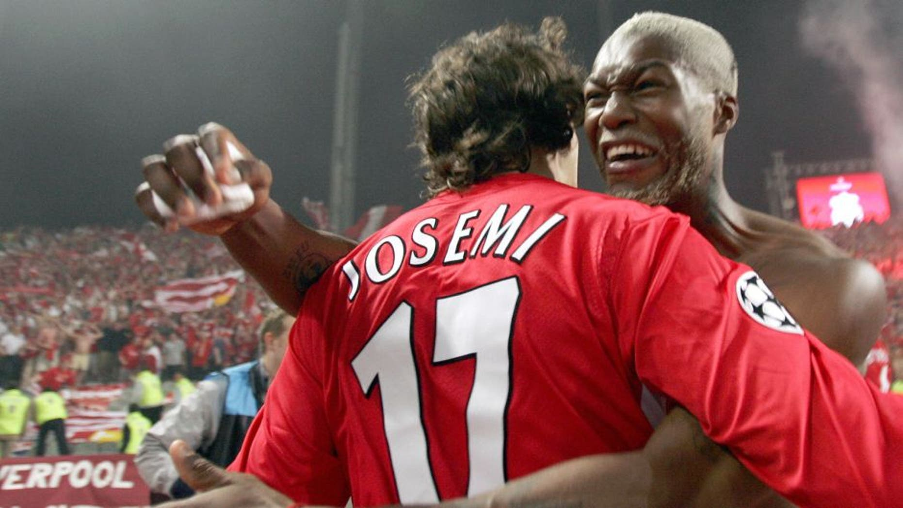Istanbul, Turkey: Liverpool's Spanish Defender Josemi Jesemi and Liverpool's French striker Djibril Cisse celebrate after winning at the UEFA Champions league football final AC Milan vs Liverpool, 25 May 2005 at the Ataturk Stadium in Istanbul. Liverpool won 3-2 on penalties. AFP PHOTO FILIPPO MONTEFORTE (Photo credit should read FILIPPO MONTEFORTE/AFP/Getty Images)