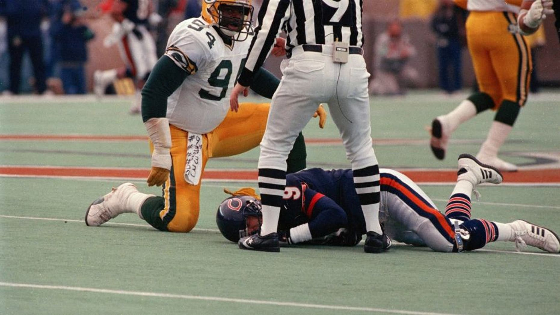 Green Bay Packer Charles Martin (94) checks on Bears quarterback Jim McMahon after slamming him to the ground Sunday, Nov. 23, 1986 at Soldier Field in Chicago. (Edward Wagner/Chicago Tribune/TNS)