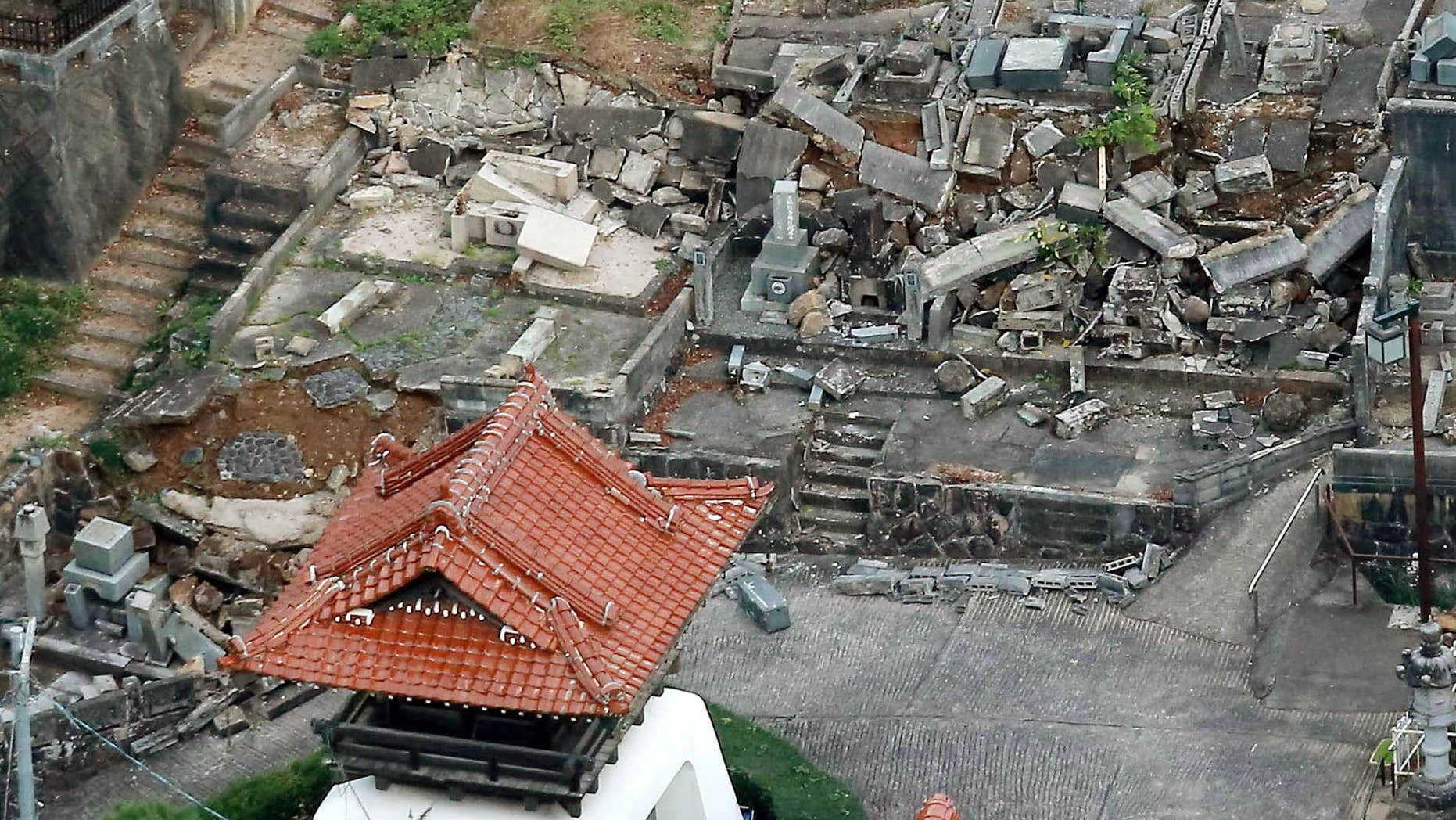 Oct. 21, 2016: This aerial photo shows fallen tomb stones scattered at a cemetery following an earthquake in Kurayoshi, Tottori prefecture.