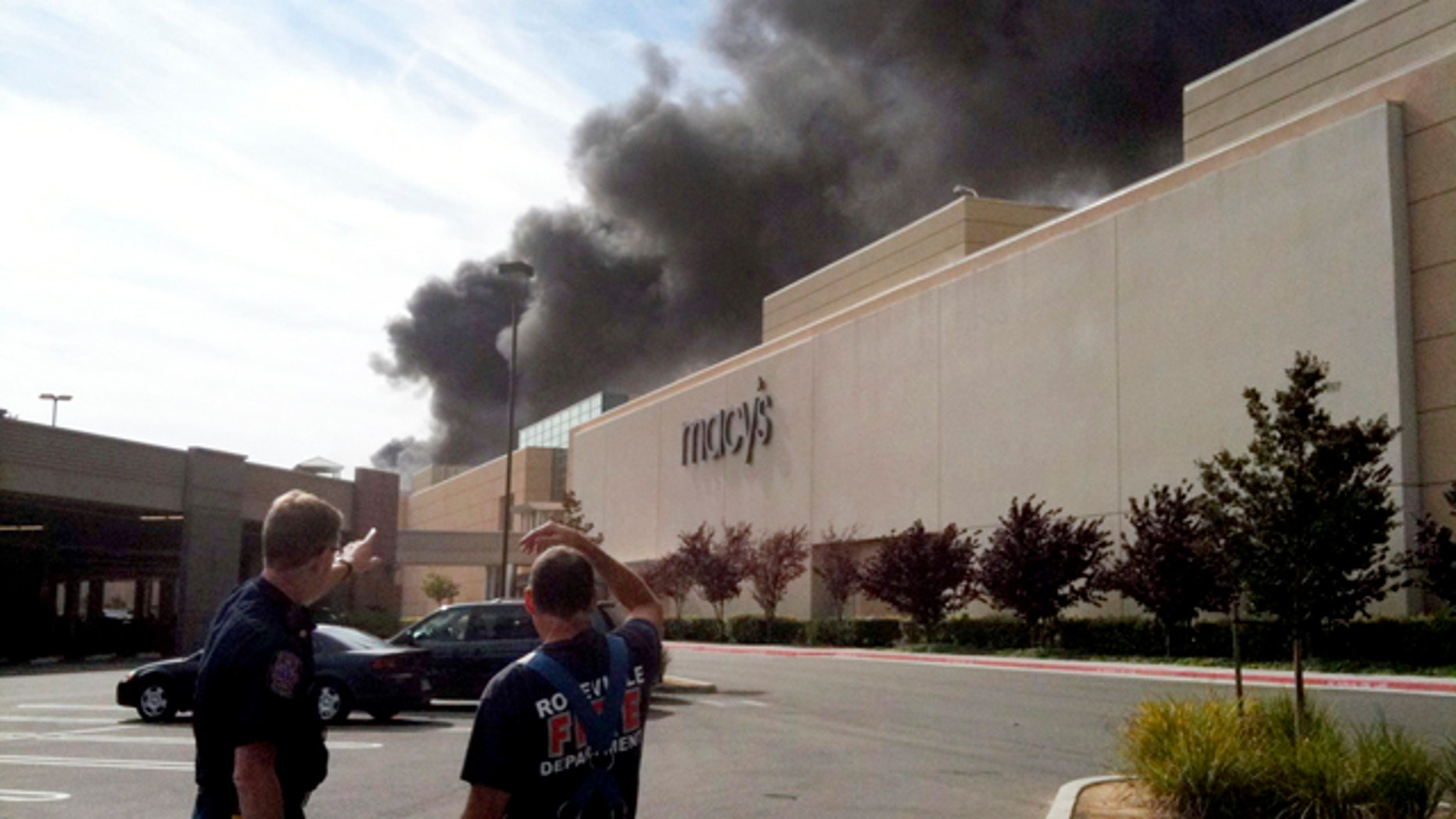 Oct. 21: Smoke billows out of the of the Roseville Galleria after a man entered a store earlier in the day and set the shop on fire in Roseville, Calif.