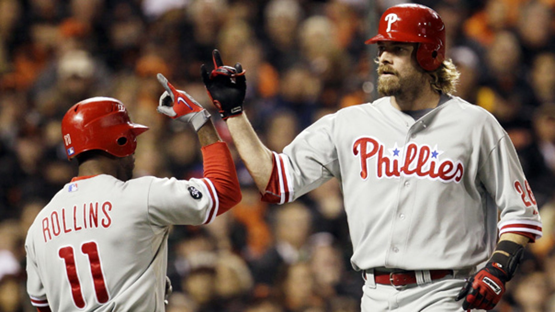 Oct. 21: Philadelphia Phillies' Jayson Werth, right, is congratulated by Jimmy Rollins after Werth hit a home run during the ninth inning in San Francisco.