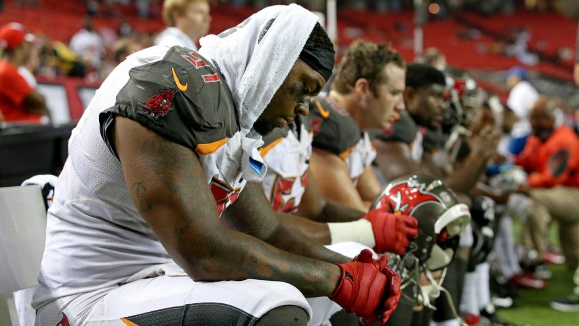 Sep 18, 2014; Atlanta, GA, USA; Tampa Bay Buccaneers defensive end Da'Quan Bowers (91) reacts on the sideline during their loss to the Atlanta Falcons in the fourth quarter at the Georgia Dome. The Falcons won 56-14. Mandatory Credit: Jason Getz-USA TODAY Sports