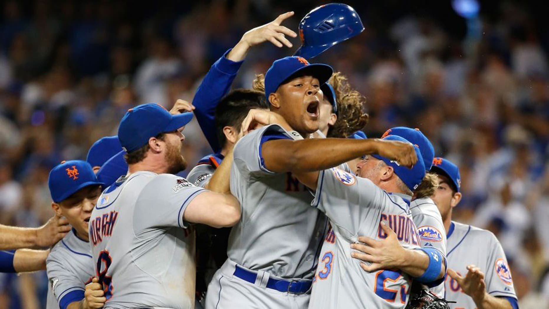 LOS ANGELES, CA - OCTOBER 15: Jeurys Familia #27 of the New York Mets celebrates after the Mets 3-2 victory against the Los Angeles Dodgers in game five of the National League Division Series at Dodger Stadium on October 15, 2015 in Los Angeles, California. (Photo by Sean M. Haffey/Getty Images)