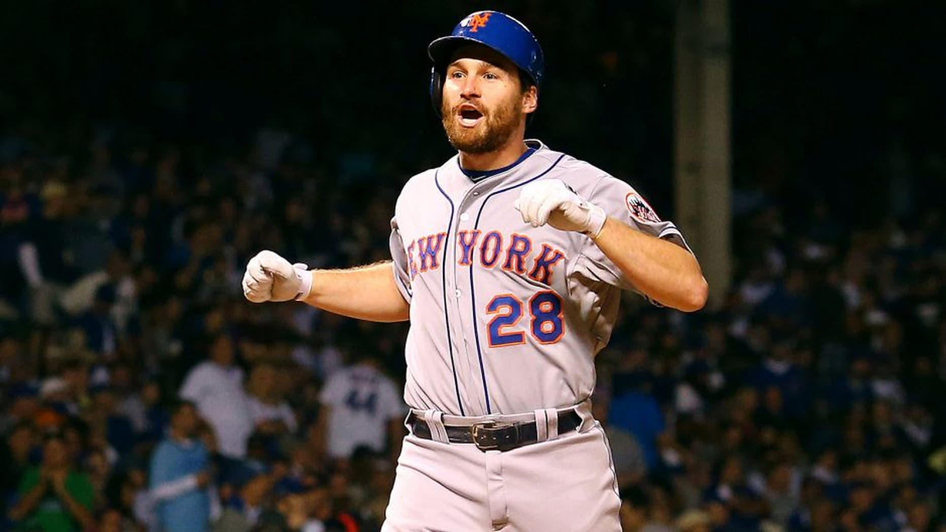 CHICAGO, IL - OCTOBER 21: Daniel Murphy #28 of the New York Mets celebrates after hitting a two run home run in the eighth inning against Pedro Strop #46 of the Chicago Cubs during game four of the 2015 MLB National League Championship Series at Wrigley Field on October 21, 2015 in Chicago, Illinois. (Photo by Elsa/Getty Images)