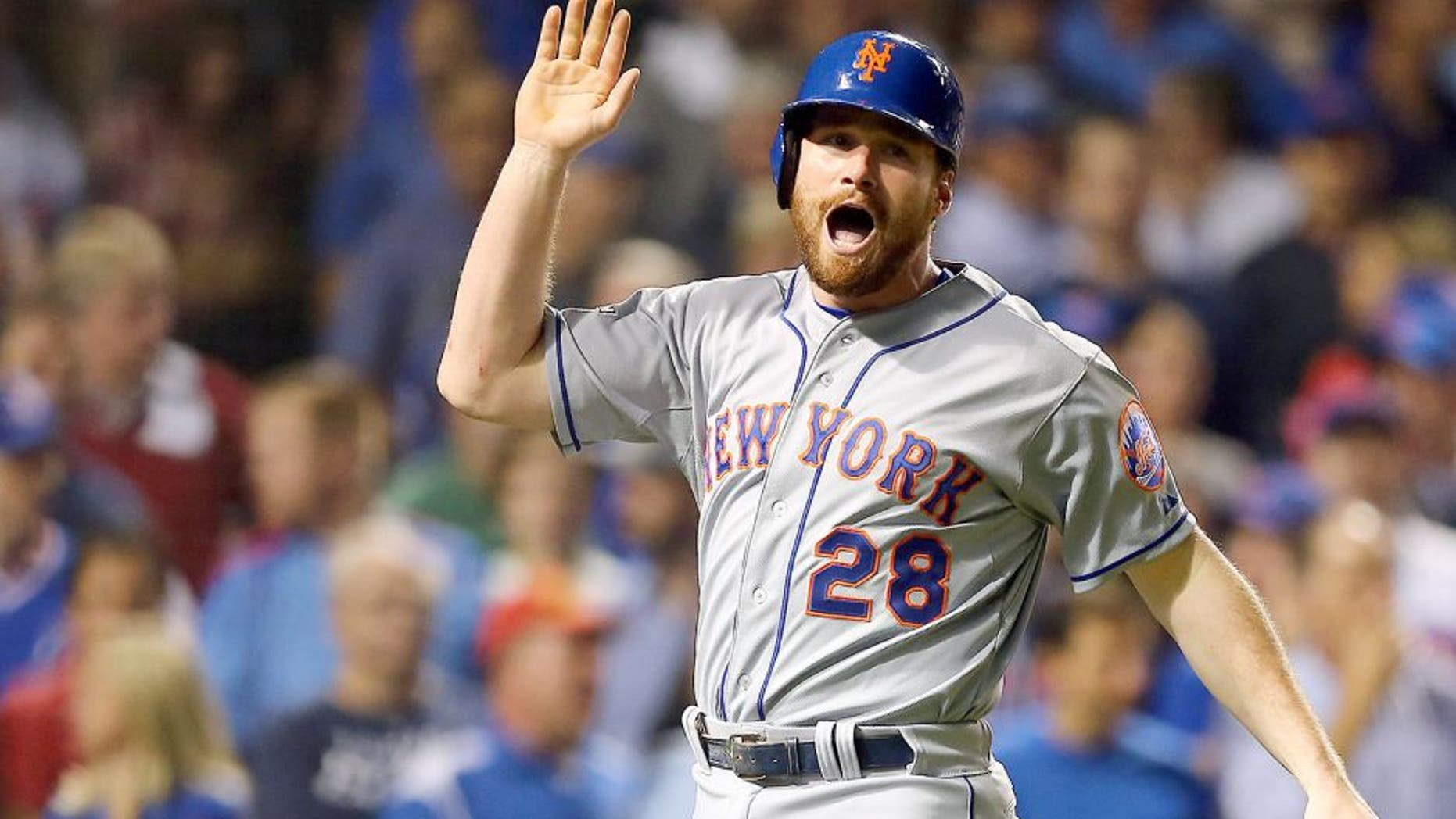 CHICAGO, IL - OCTOBER 21: Daniel Murphy #28 of the New York Mets celebrates after scoring off of a double hit by Lucas Duda #21 of the New York Mets in the second inning against Travis Wood #37 of the Chicago Cubs during game four of the 2015 MLB National League Championship Series at Wrigley Field on October 21, 2015 in Chicago, Illinois. (Photo by Elsa/Getty Images)