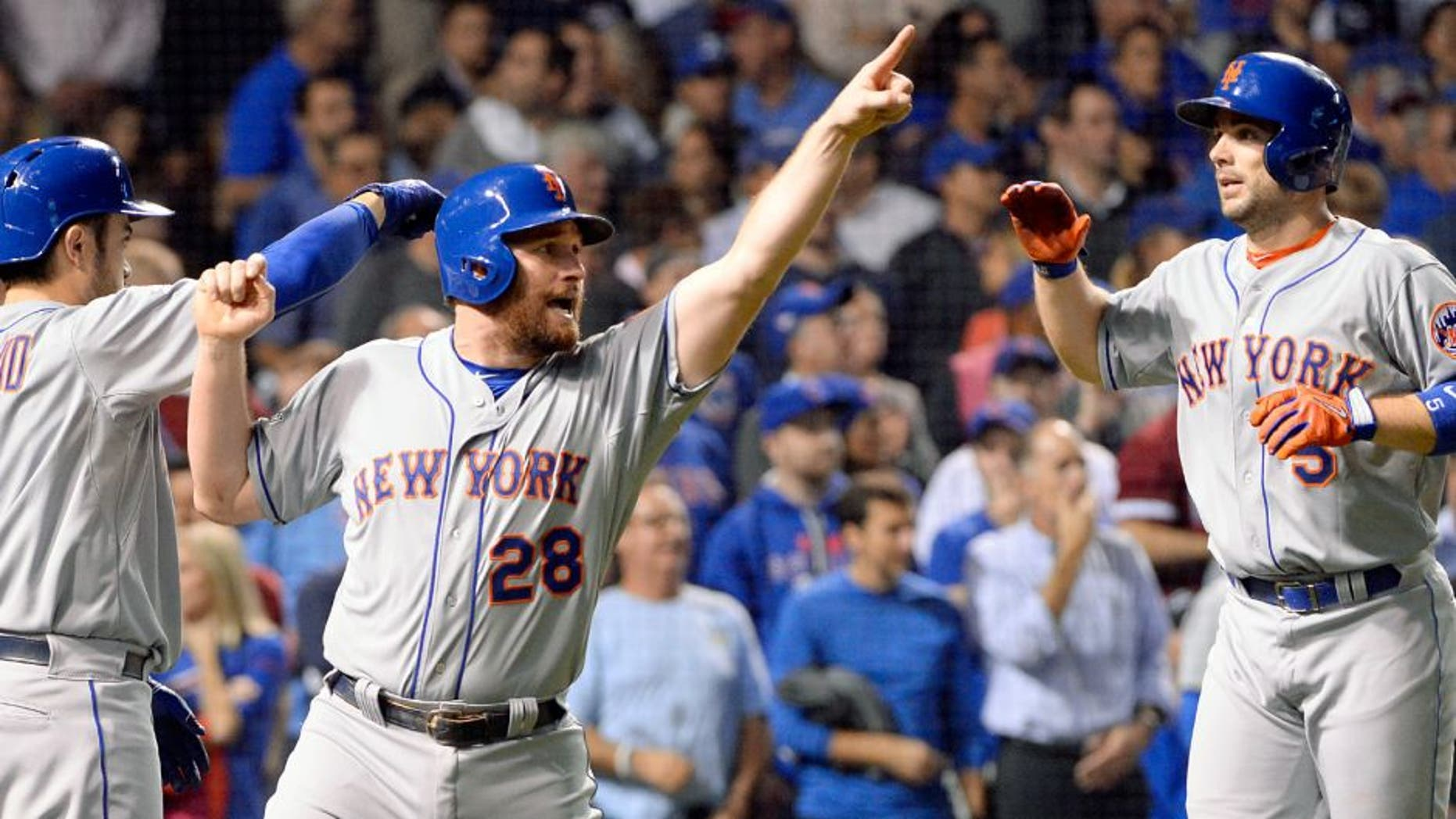 CHICAGO, IL - OCTOBER 21: Daniel Murphy #28 and David Wright #5 of the New York Mets celebrate after scoring on Lucas Duda's two-RBI double in the second inning of Game 4 of the NLCS against the Chicago Cubs at Wrigley Field on Wednesday, October 21, 2015 in Chicago, Illinois. (Photo by Ron Vesely/MLB Photos via Getty Images)