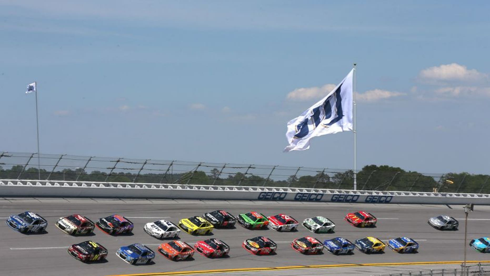 Jimmie Johnson, driver of the #48 Lowe's Chevrolet, and Jeff Gordon, driver of the #24 Drive To End Hunger Chevrolet, lead the field during the NASCAR Sprint Cup Series GEICO 500 at Talladega Superspeedway on May 3, 2015 in Talladega, Alabama.