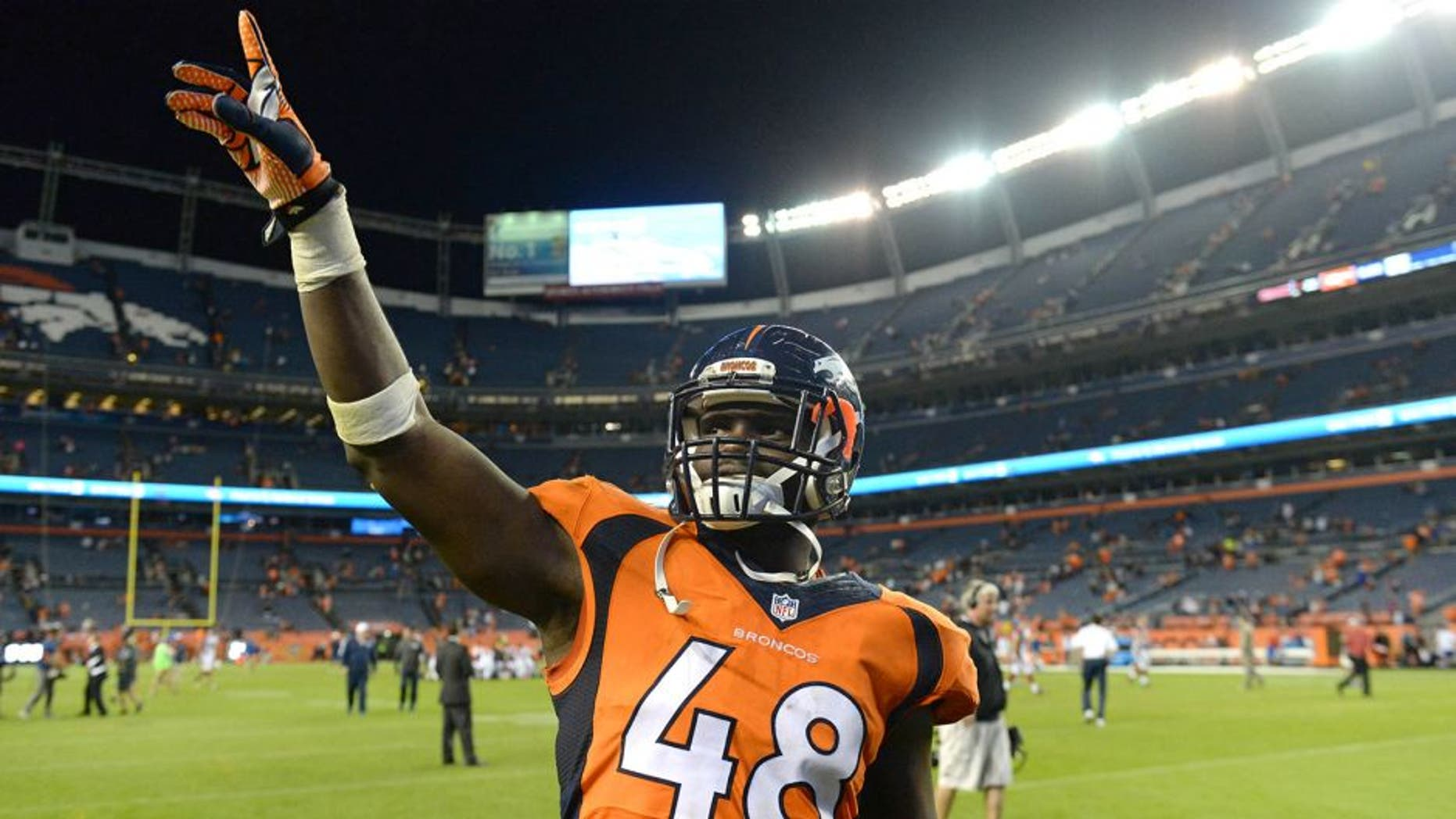 Sep 3, 2015; Denver, CO, USA; Denver Broncos linebacker Shaquil Barrett (48) leaves the field following the preseason loss to the Arizona Cardinals at Sports Authority Field at Mile High. The Cardinals defeated the Broncos 22-20. Mandatory Credit: Ron Chenoy-USA TODAY Sports