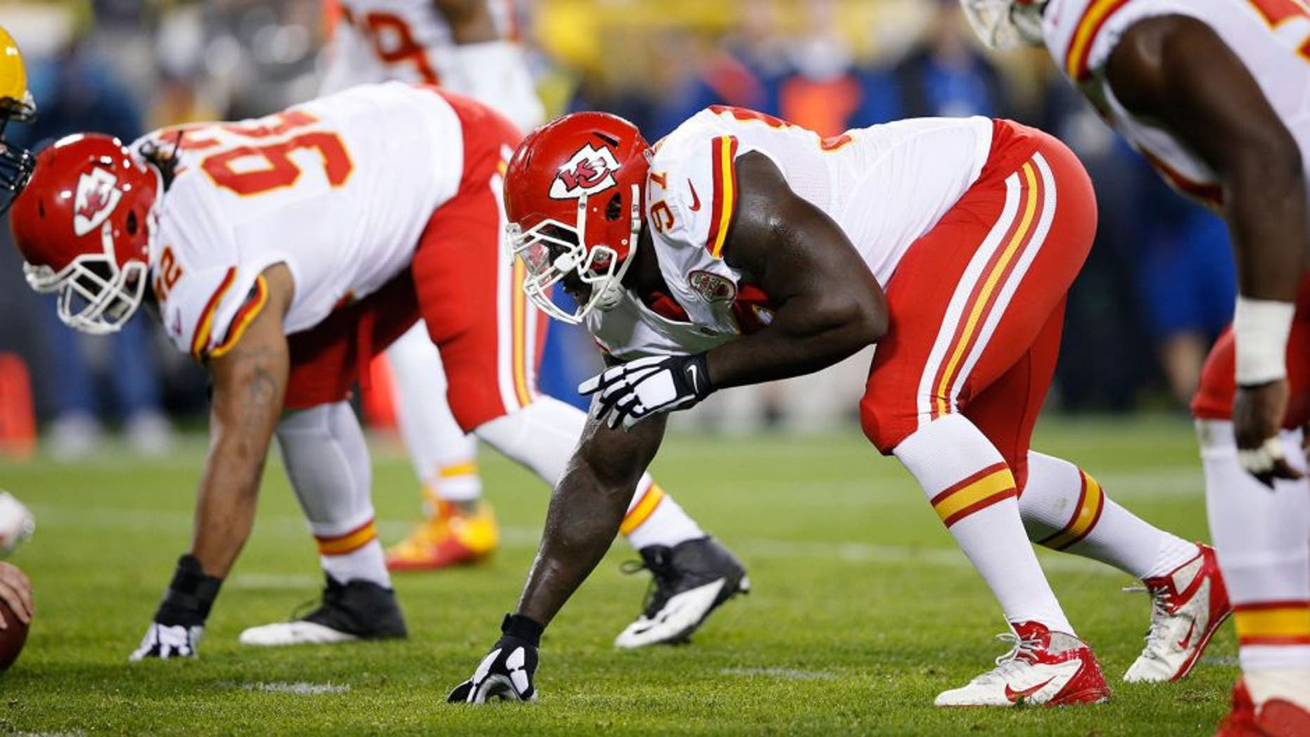 GREEN BAY, WI - SEPTEMBER 28: Allen Bailey #97 of the Kansas City Chiefs lines up against the Green Bay Packers during a game at Lambeau Field on September 28, 2015 in Green Bay, Wisconsin. The Packers defeated the Chiefs 38-28. (Photo by Joe Robbins/Getty Images)