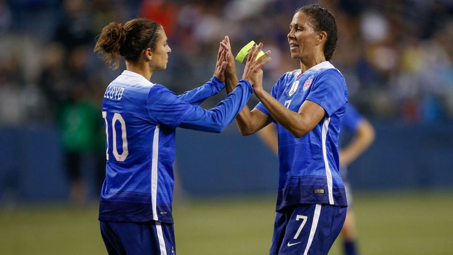 SEATTLE, WA - OCTOBER 21: Shannon Boxx #7 of the United States is congratulated by Carli Lloyd #10 as she is removed from the match in the first half against Brazil at CenturyLink Field on October 21, 2015 in Seattle, Washington. (Photo by Otto Greule Jr/Getty Images)