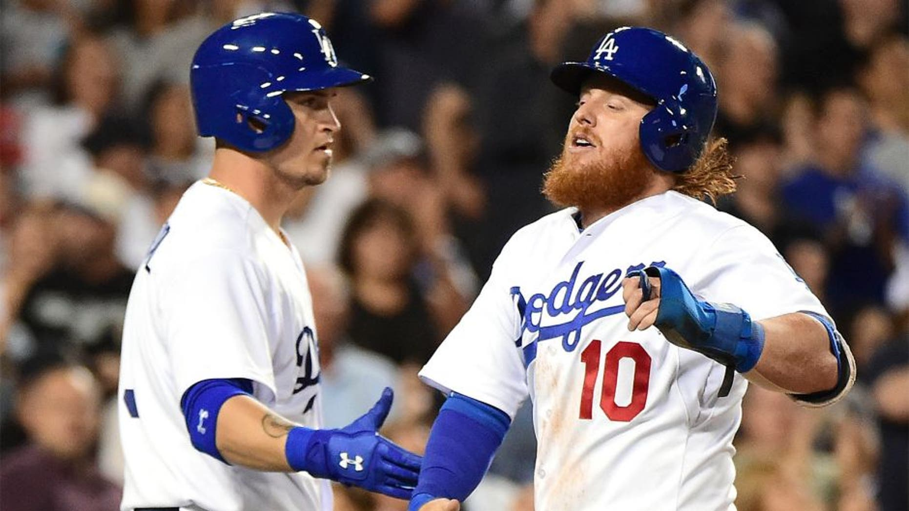 LOS ANGELES, CA - SEPTEMBER 02: Justin Turner #10 of the Los Angeles Dodgers celebrates his run with Yasmani Grandal #9 to take a 1-0 lead over the San Francisco Giants during the second inning at Dodger Stadium on September 2, 2015 in Los Angeles, California. (Photo by Harry How/Getty Images)