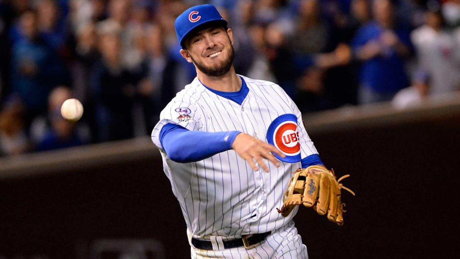 CHICAGO, IL - OCTOBER 20: Kris Bryant #17 of the Chicago Cubs throws to first base during Game 3 of the NLCS against the New York Mets at Wrigley Field on Tuesday, October 20, 2015 in Chicago , Illinois. (Photo by Ron Vesely/MLB Photos via Getty Images)