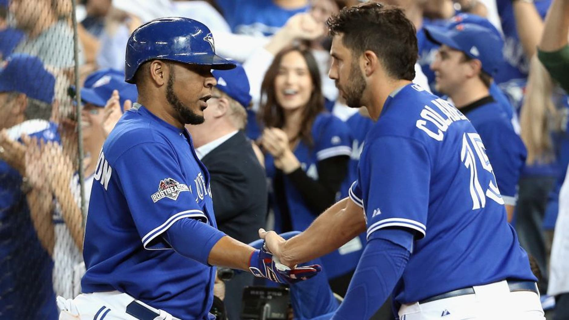 TORONTO, ON - OCTOBER 21: Edwin Encarnacion #10 of the Toronto Blue Jays is congratulated by Chris Colabello #15 of the Toronto Blue Jays after scoring a run in the sixth inning against the Kansas City Royals during game five of the American League Championship Series at Rogers Centre on October 21, 2015 in Toronto, Canada. (Photo by Tom Szczerbowski/Getty Images)