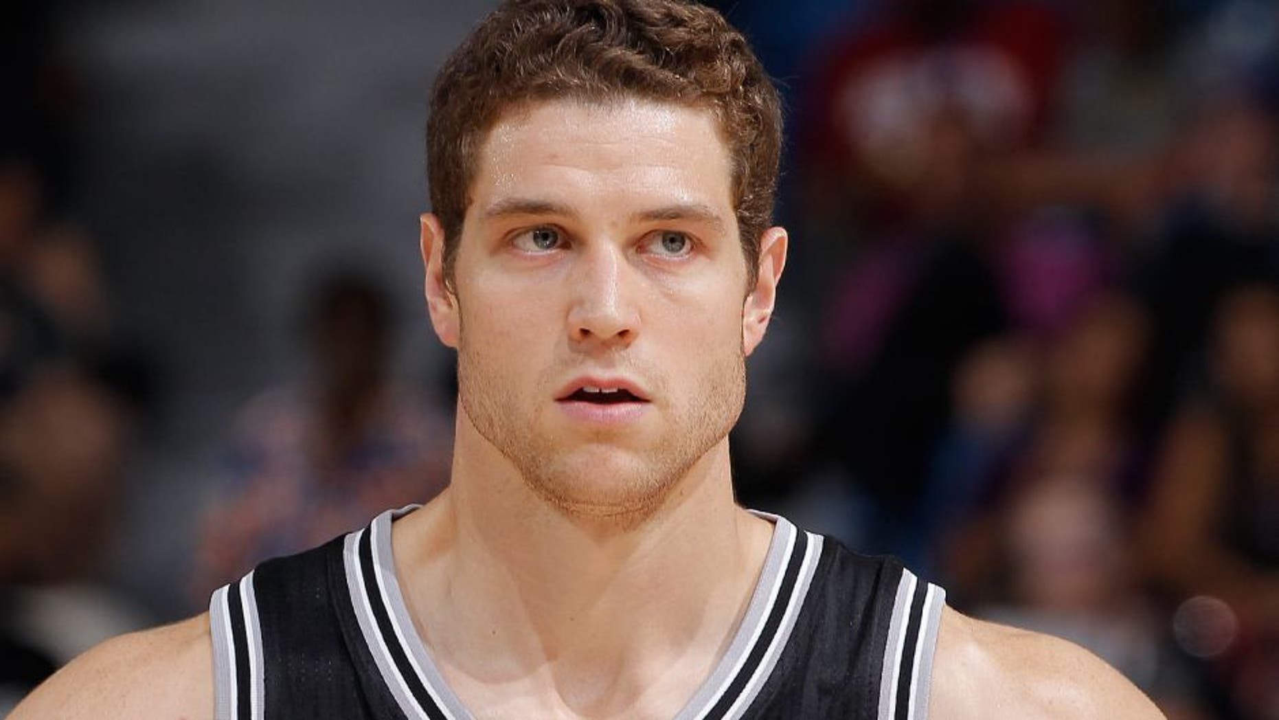 SACRAMENTO, CA - OCTOBER 8: Jimmer Fredette #16 of the San Antonio Spurs looks on during the game against the Sacramento Kings on October 8, 2015 at Sleep Train Arena in Sacramento, California. NOTE TO USER: User expressly acknowledges and agrees that, by downloading and or using this photograph, User is consenting to the terms and conditions of the Getty Images Agreement. Mandatory Copyright Notice: Copyright 2015 NBAE (Photo by Rocky Widner/NBAE via Getty Images)