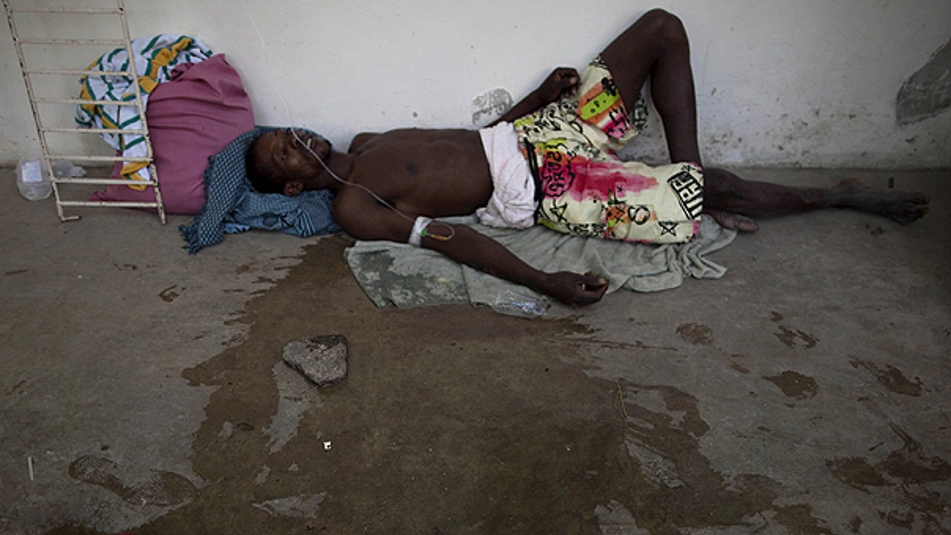 Oct. 22: A man suffering from cholera symptoms lies on the floor of the hospital in Marchand Dessalines, Haiti.