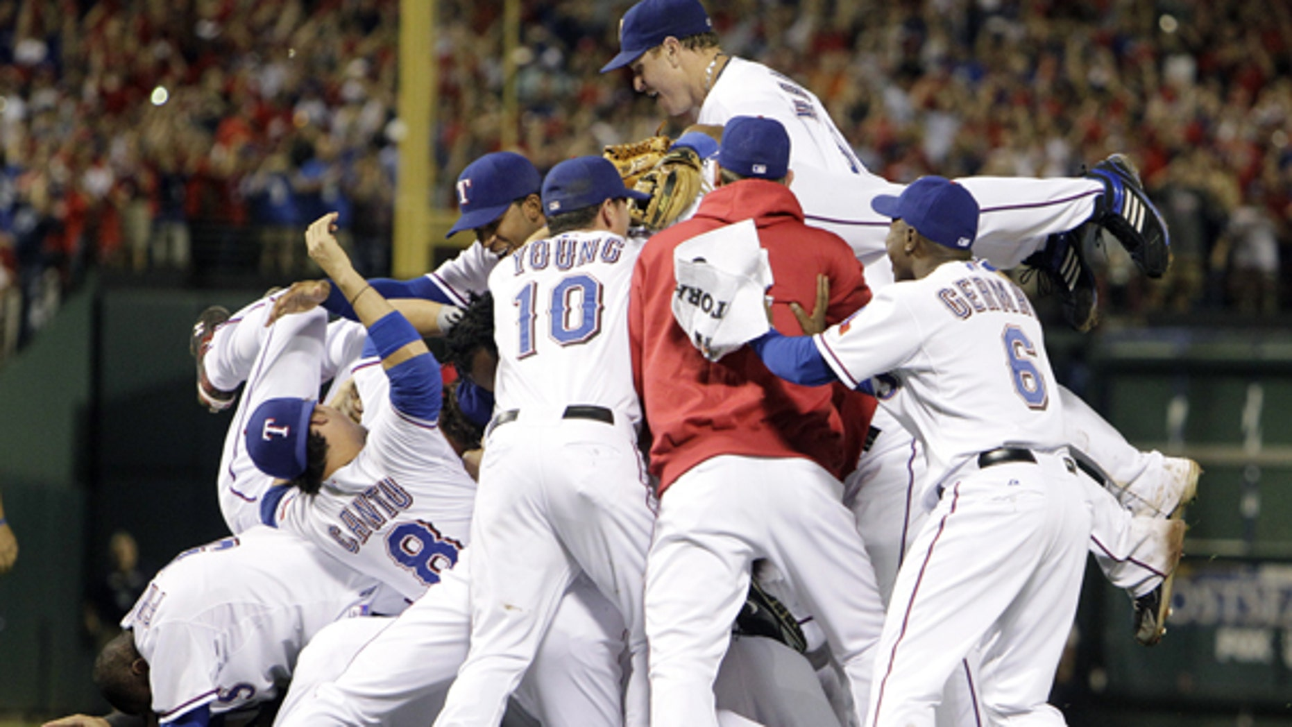 Oct. 22: Texas Rangers players celebrate after a 6-1 over the New York Yankees win in the deciding Game 6 of baseball's American League Championship Series in Arlington, Texas.